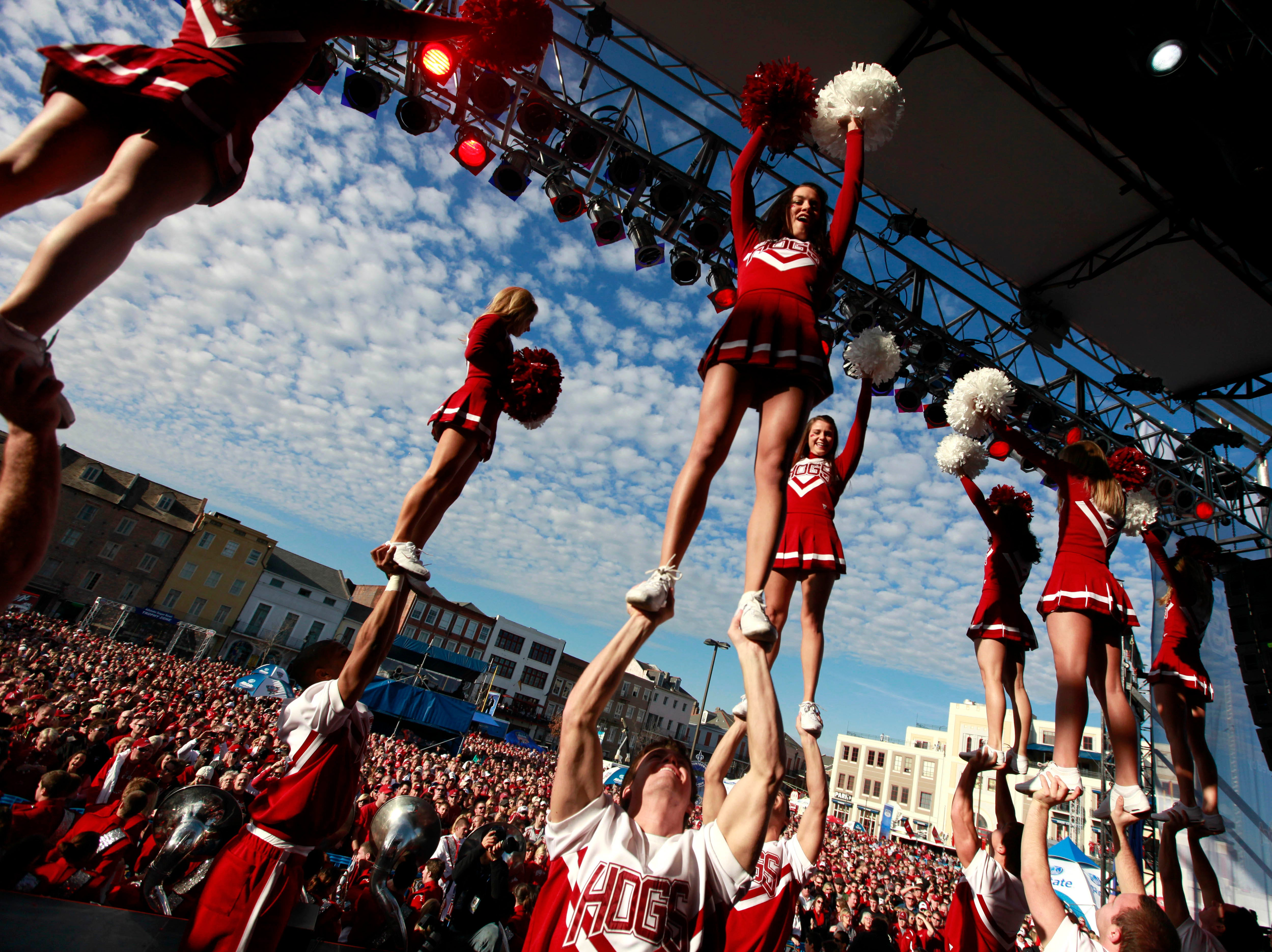 University of Arkansas cheerleaders perform for fans at a pep rally for the upcoming NCAA football BCS Sugar Bowl game against Ohio State in New Orleans, Monday, Jan. 3, 2011. (AP Photo/Gerald Herbert)