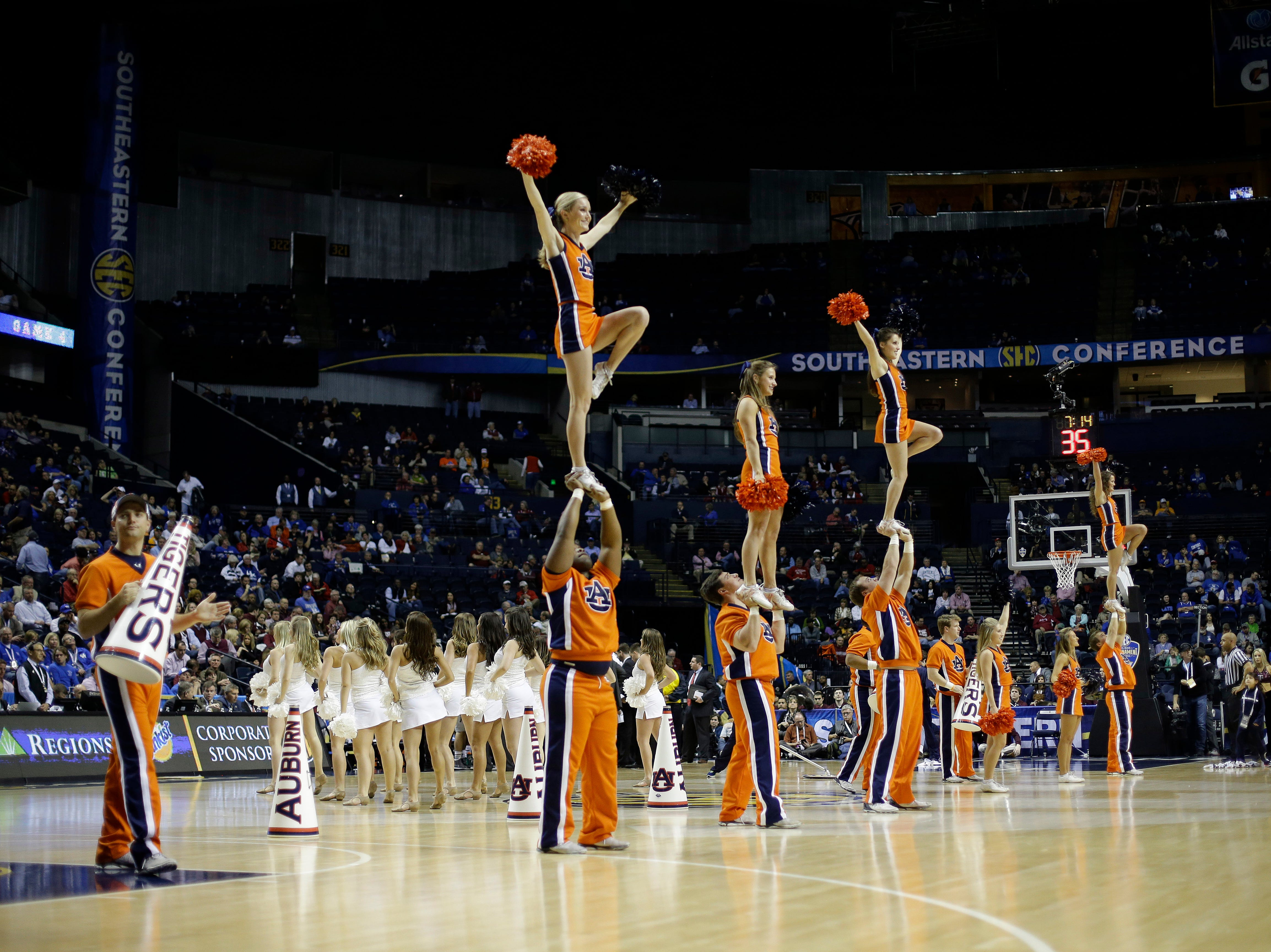 Auburn cheerleaders perform during the second half of an NCAA college basketball game in the second round of the Southeastern Conference tournament between Texas A&M and Auburn, Thursday, March 12, 2015, in Nashville, Tenn. (AP Photo/Mark Humphrey)