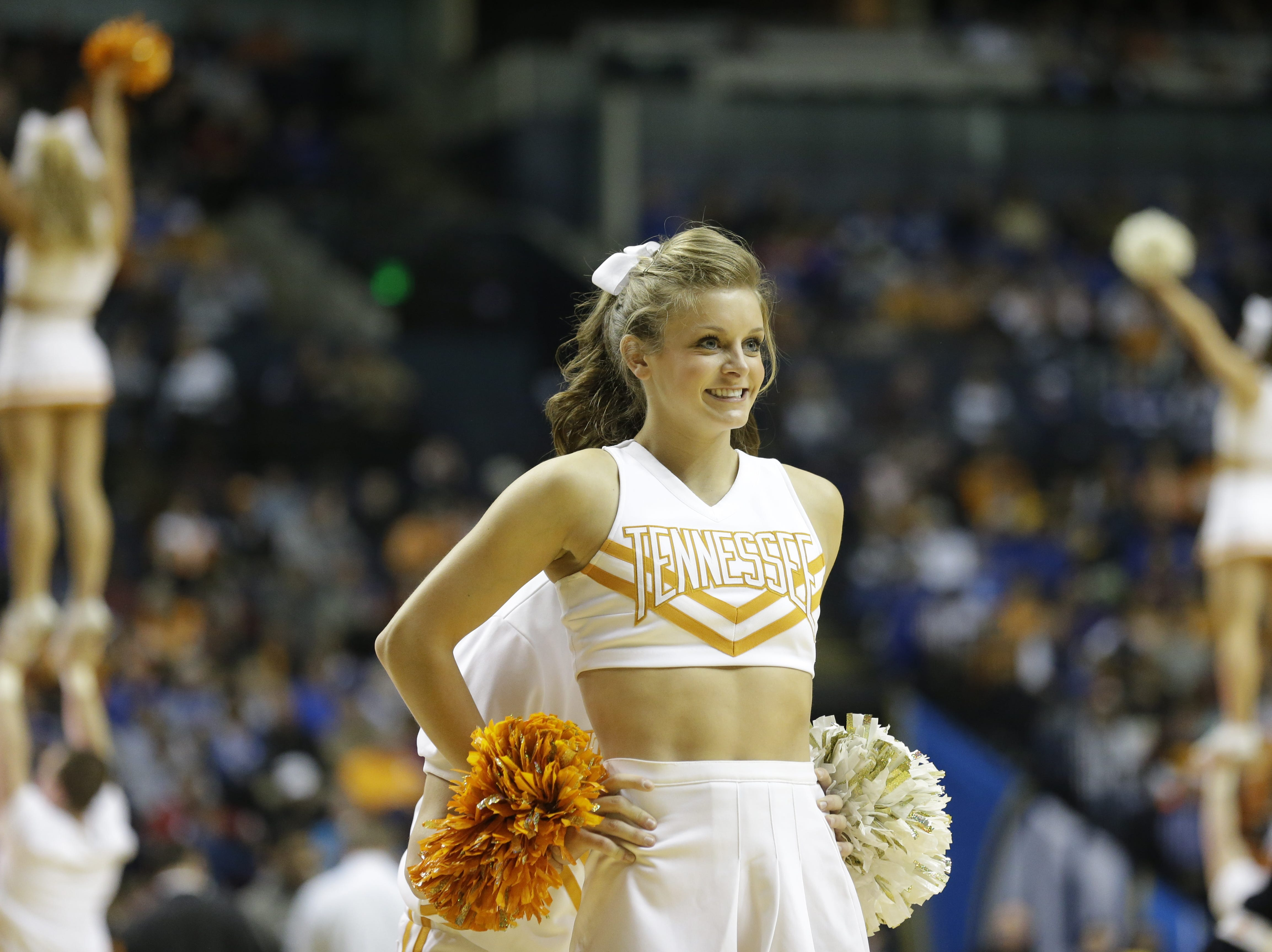 Tennessee cheerleaders perform during the first half of an NCAA college basketball game against the Mississippi State at the Southeastern Conference tournament, Thursday, March 14, 2013, in Nashville, Tenn. (AP Photo/John Bazemore)