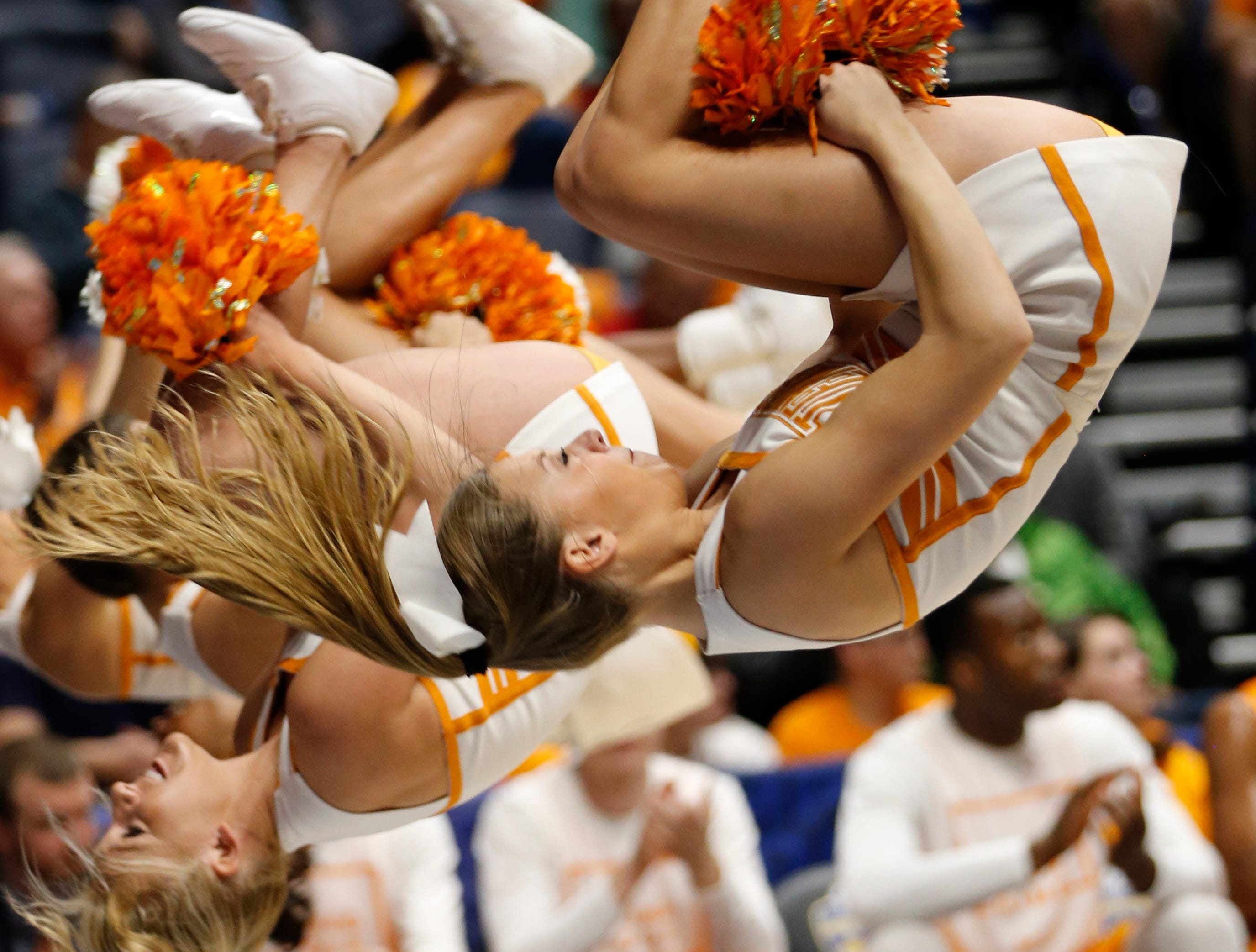 Tennessee cheerleaders perform during the first half of an NCAA college basketball game against Vanderbilt in the Southeastern Conference tournament in Nashville, Tenn., Thursday, March 10, 2016. (AP Photo/John Bazemore)