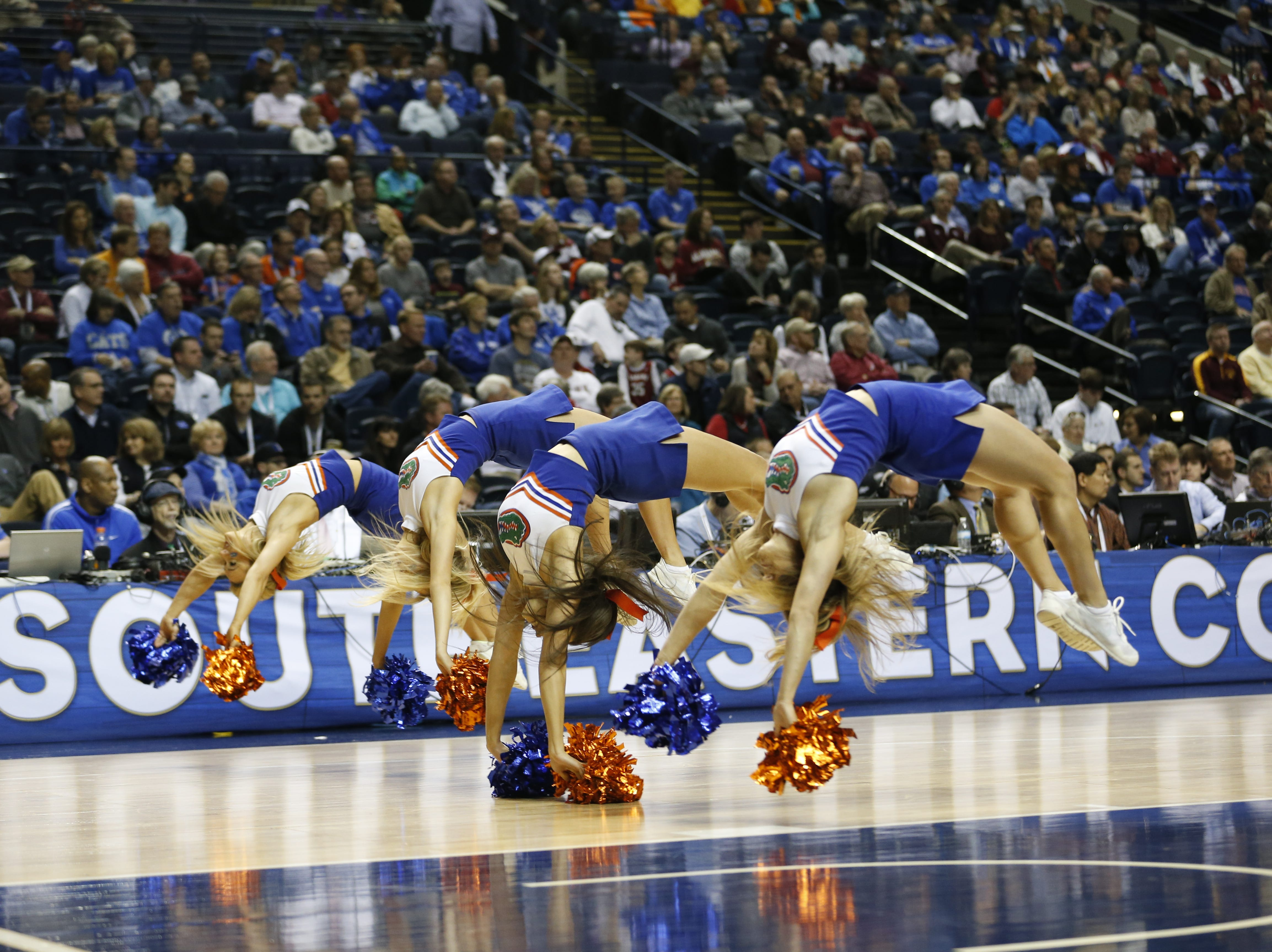 Florida cheerleaders perform during the first half of an NCAA college basketball game in the second round of the Southeastern Conference tournament between Alabama and Florida, Thursday, March 12, 2015, in Nashville, Tenn. (AP Photo/Steve Helber)