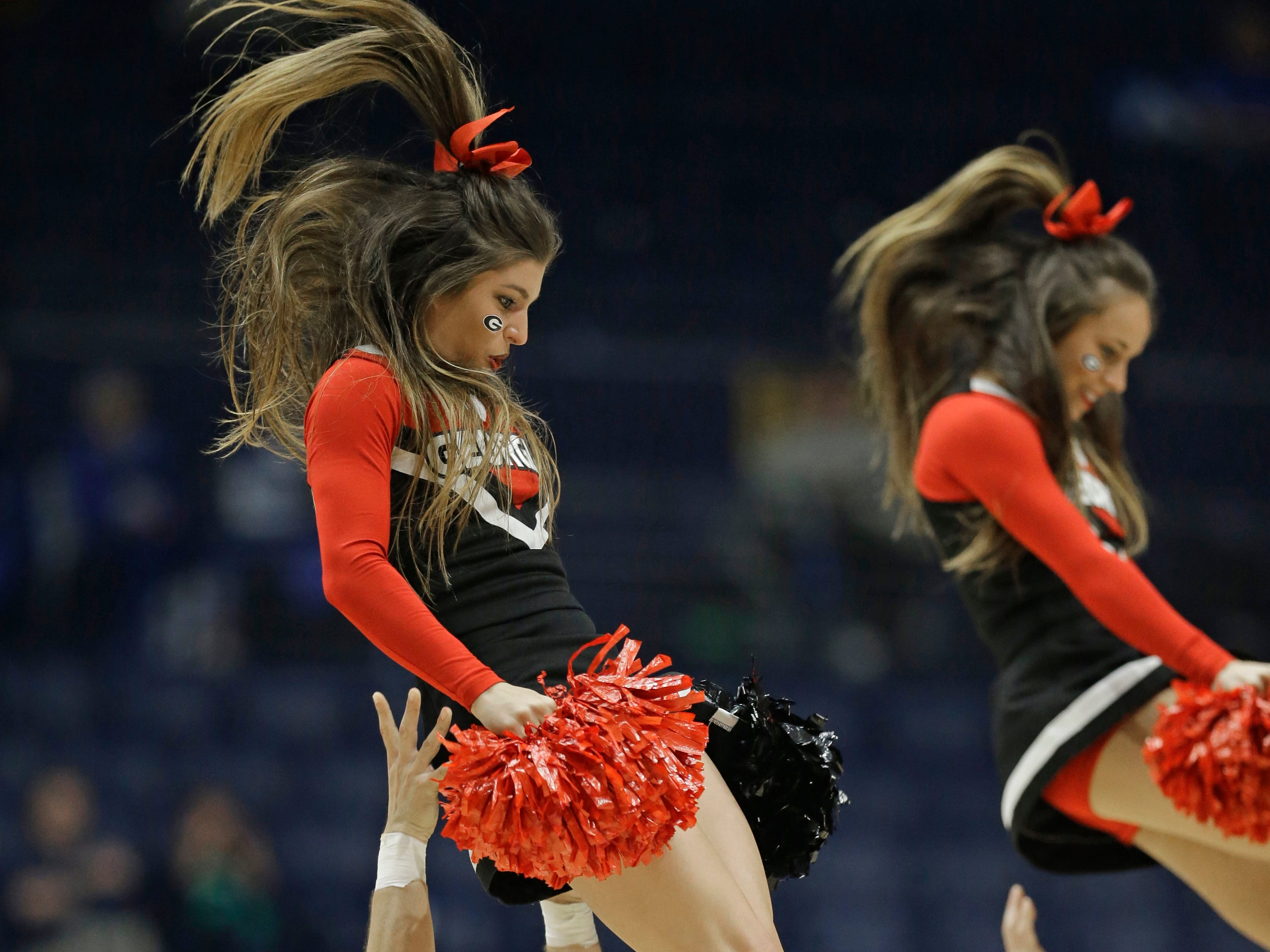 Georgia cheerleaders perform during the second half of an NCAA college basketball game against South Carolina in the Southeastern Conference tournament in Nashville, Tenn., Friday, March 11, 2016. (AP Photo/Mark Humphrey)
