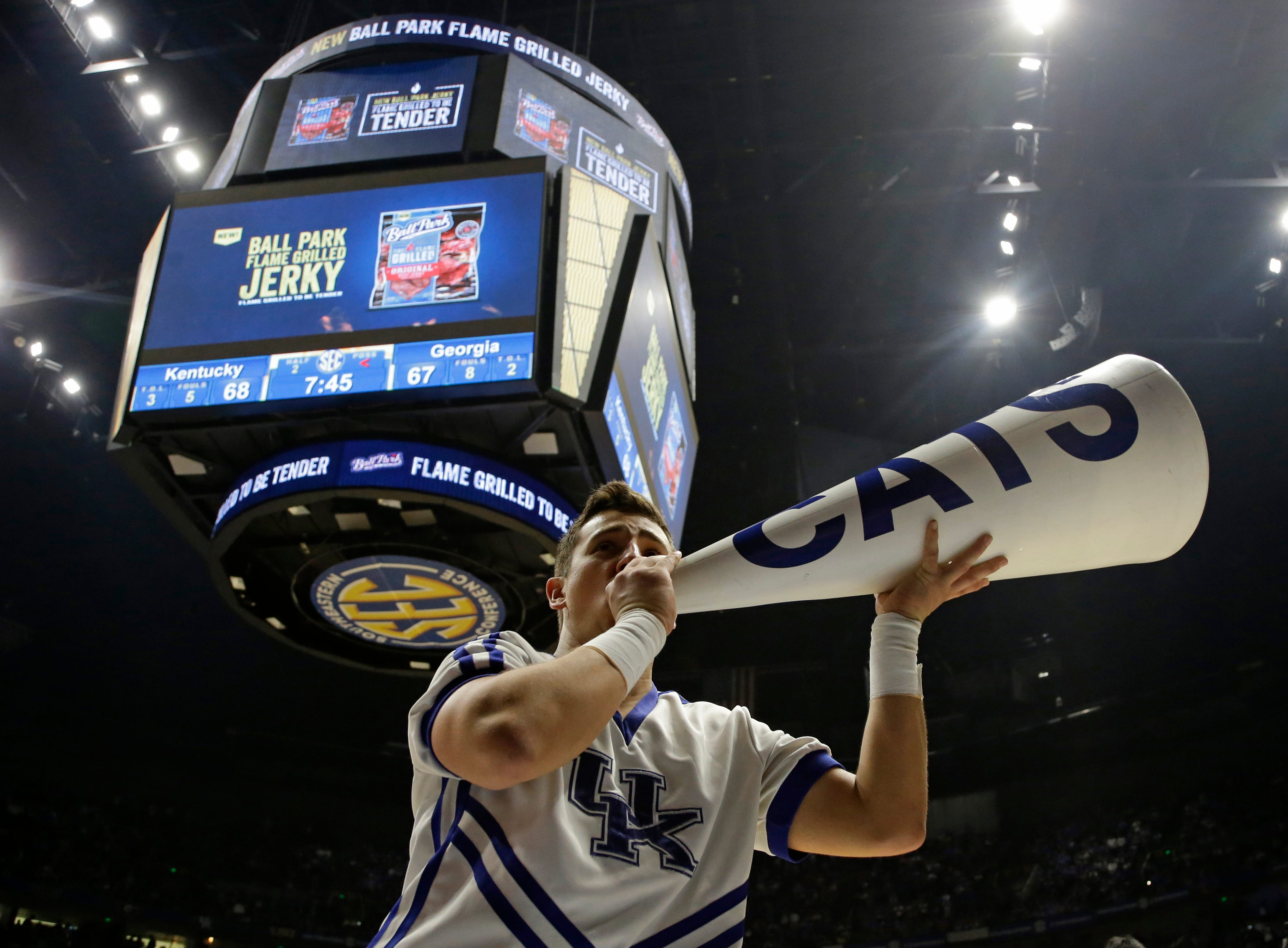 A Kentucky cheerleader performs during the second half of an NCAA college basketball game against Georgia in the Southeastern Conference tournament in Nashville, Tenn., Saturday, March 12, 2016. (AP Photo/Mark Humphrey)