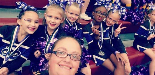 Coach Kimberly Clark enjoys a selfie with team members.