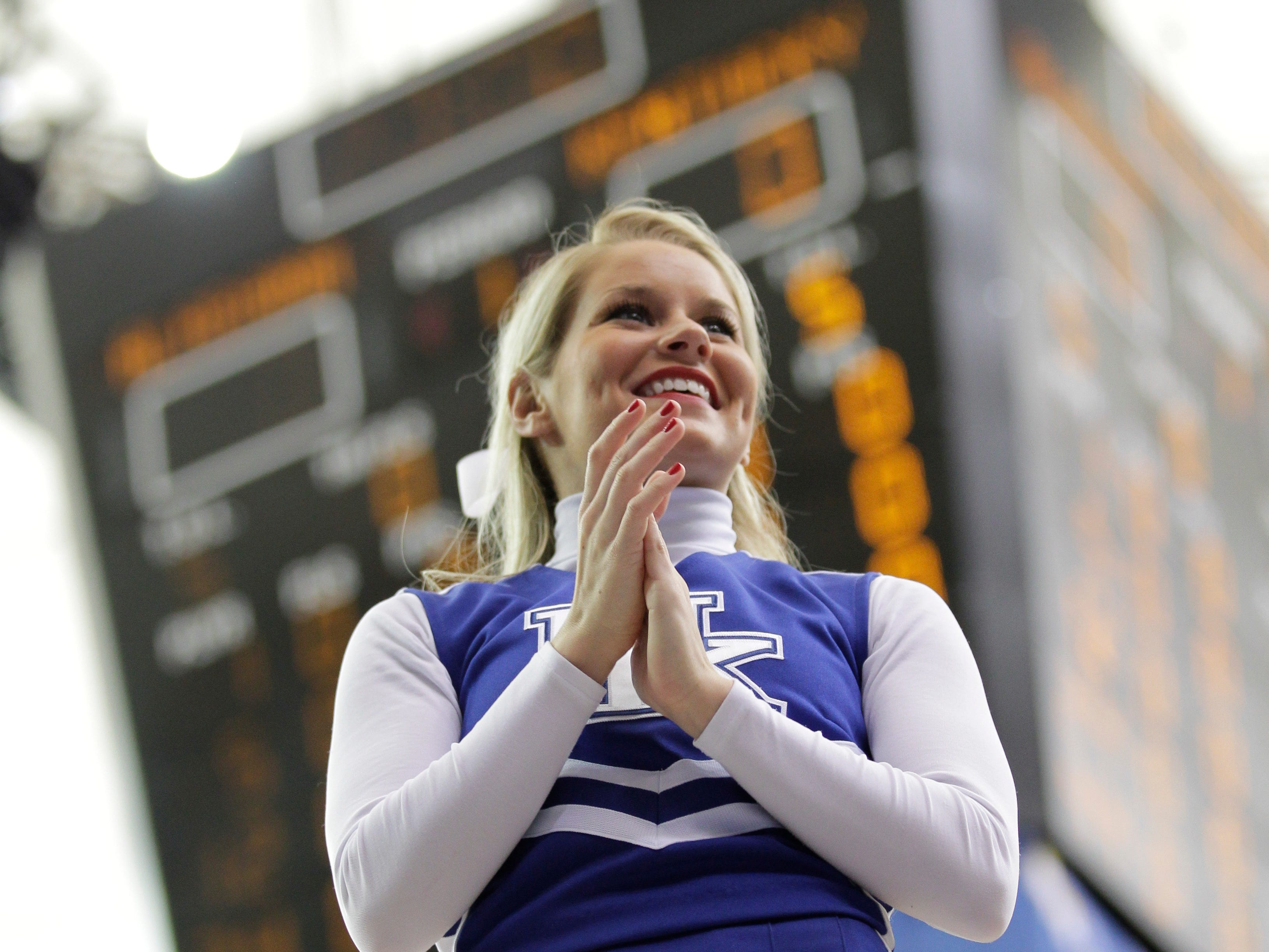 A Kentucky cheerleader performs during the first half of an NCAA college basketball game against Alabama at the Southeastern Conference tournament, Saturday, March 12, 2011, in Atlanta. (AP Photo/Dave Martin)