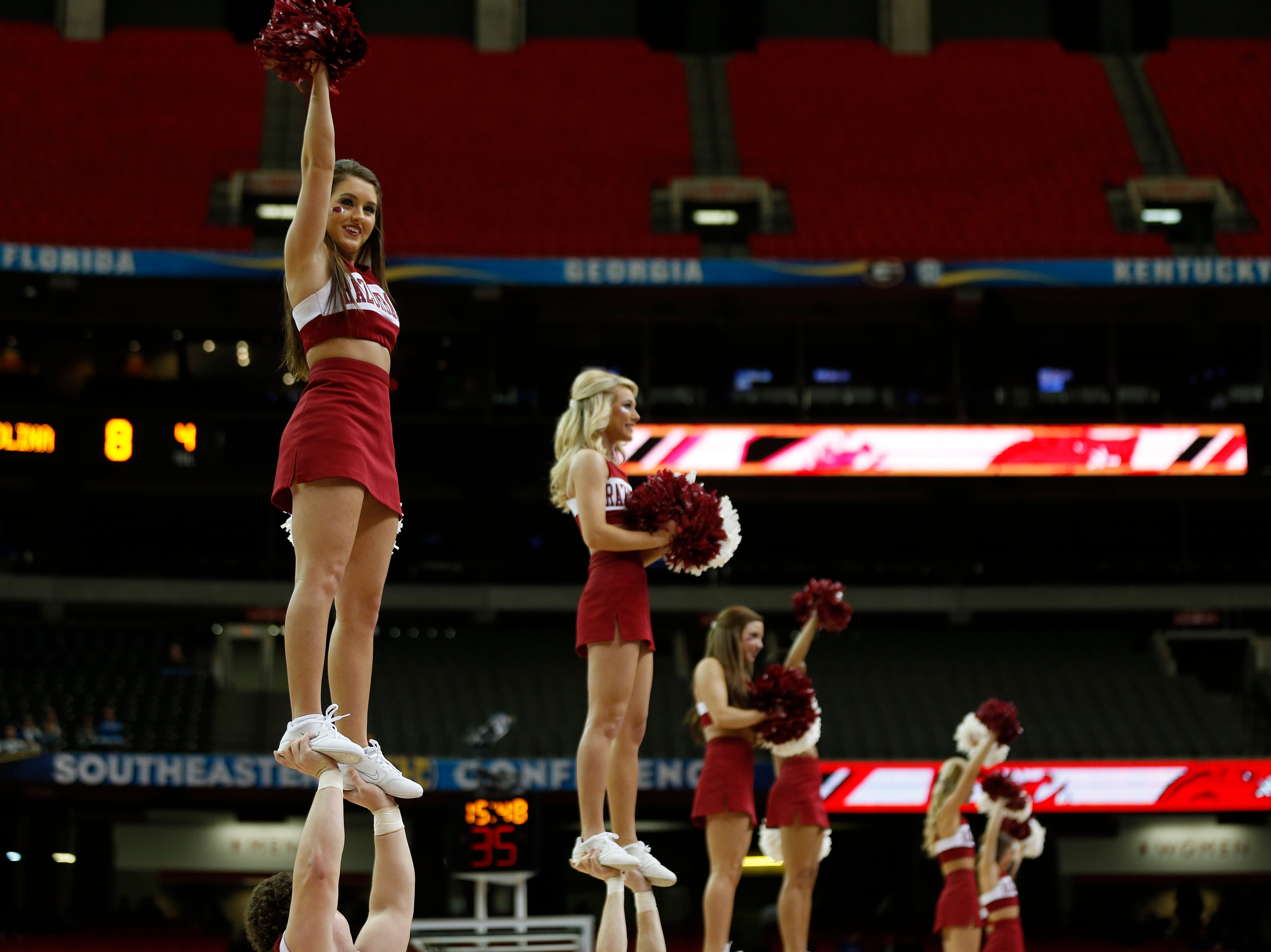 Arkansas cheerleaders perform during the first half of an NCAA college basketball game against the South Carolina in the second round of the Southeastern Conference men's tournament, Thursday, March 13, 2014, in Atlanta. (AP Photo/John Bazemore)