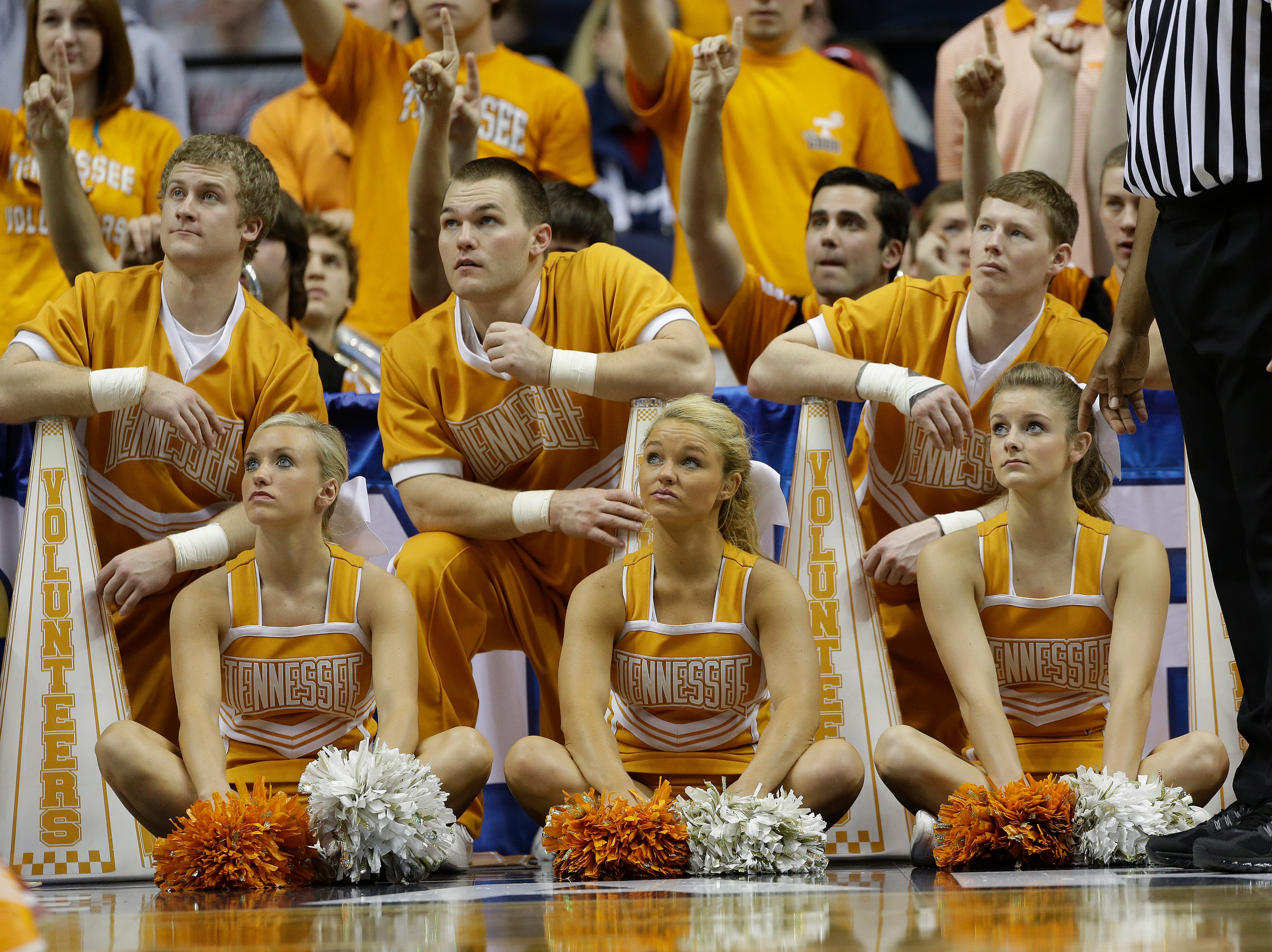 Tennessee cheerleaders watch the closing minutes of the second half of an NCAA college basketball game against Alabama at the Southeastern Conference tournament, Friday, March 15, 2013, in Nashville, Tenn. Alabama won 58-48. (AP Photo/Dave Martin)