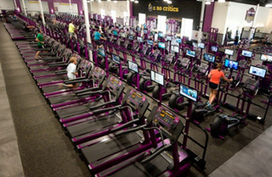 The spacious workout area at Planet Fitness includes equipment for every muscle group; a 30-minute circuit program provides a fast, effective full-body workout.