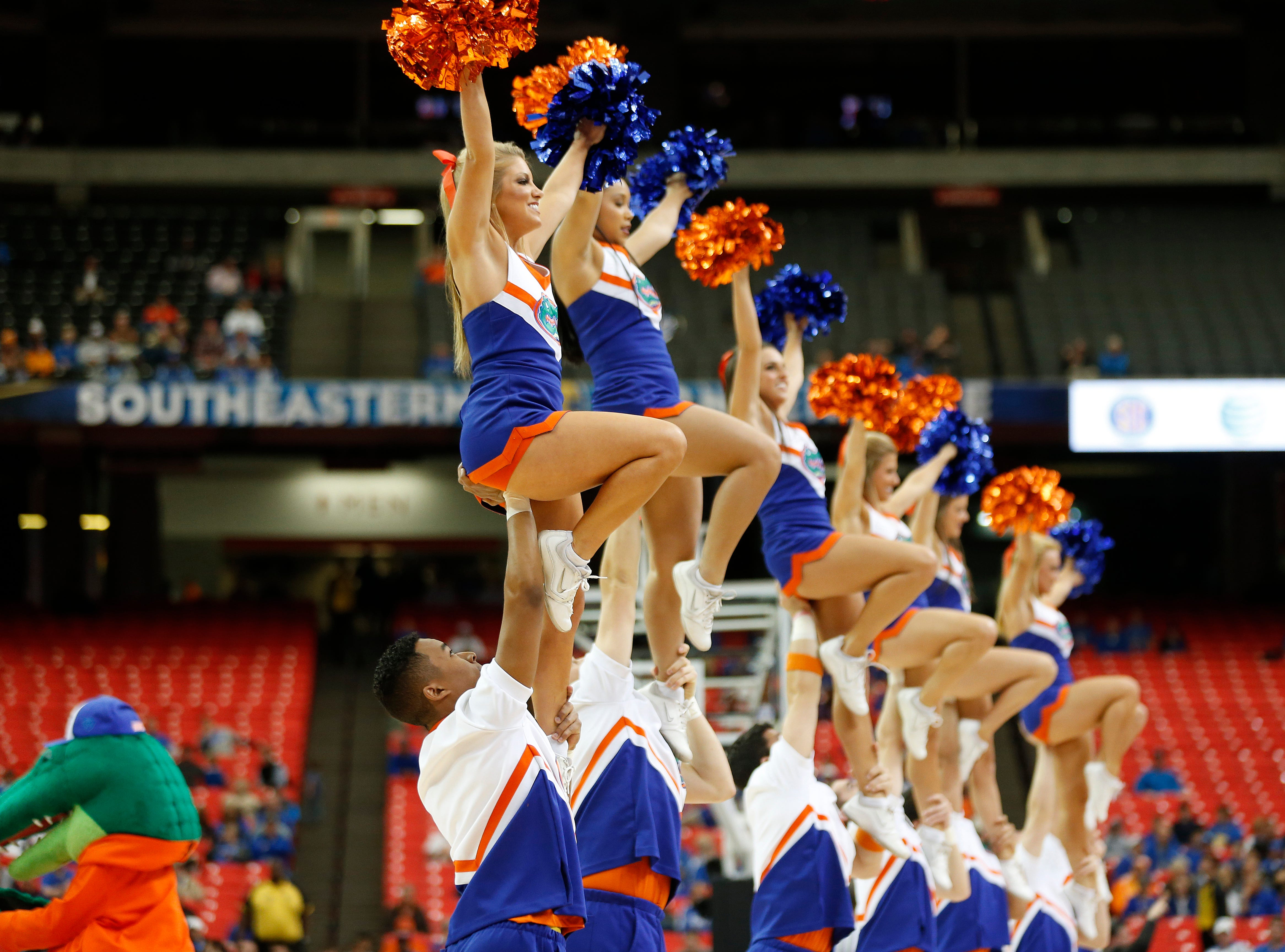 Florida cheerleaders perform during the first half of an NCAA college basketball game against the Missouri in the quarterfinal round of the Southeastern Conference men's tournament, Friday, March 14, 2014, in Atlanta. (AP Photo/John Bazemore)