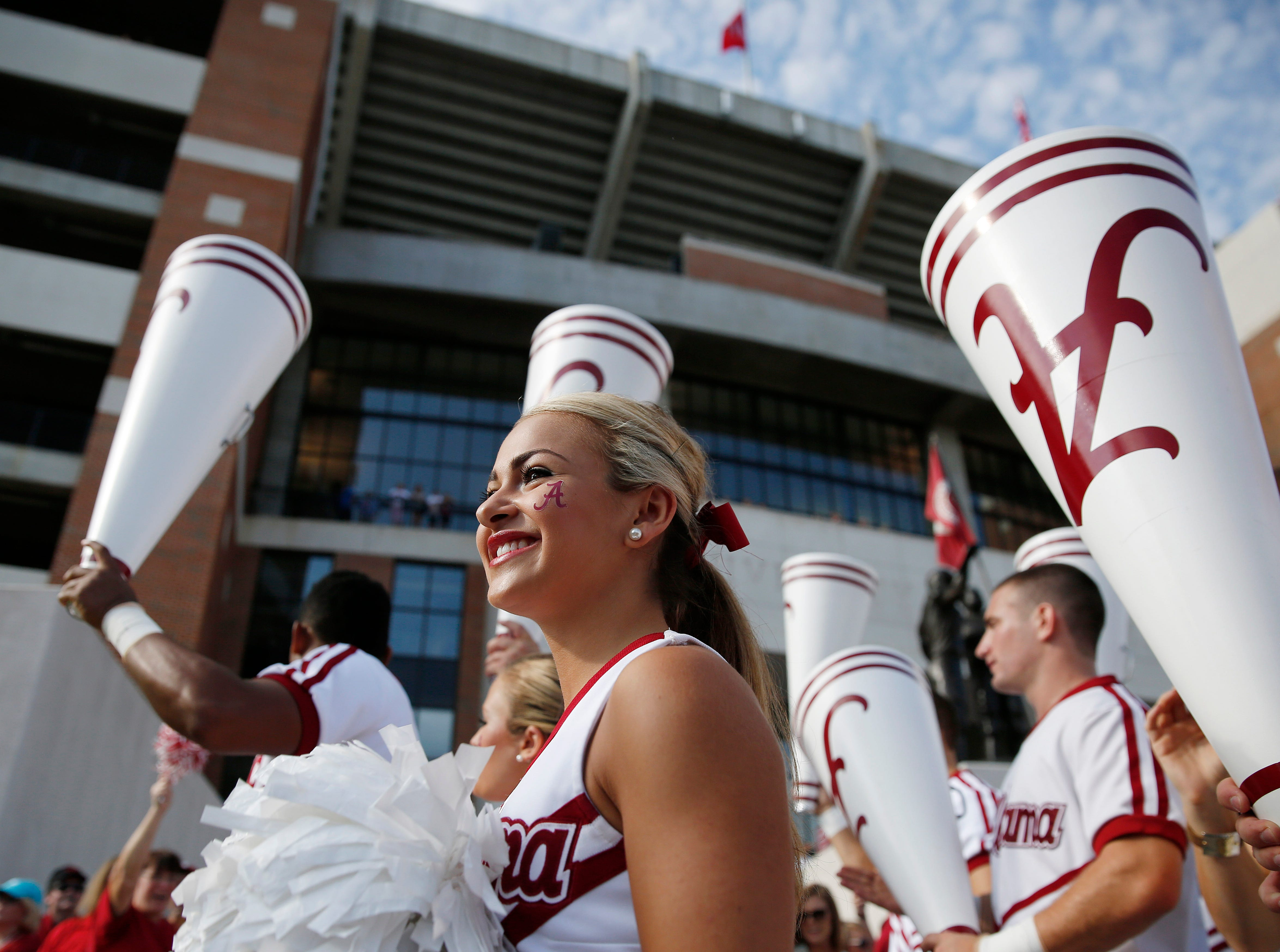 Alabama cheerleaders lead the crowd in a cheer as the team walks into Bryant–Denny Stadium before Florida Atlantic plays Alabama on Saturday, Sept. 6, 2014, in Tuscaloosa, Ala. (AP Photo/Brynn Anderson)