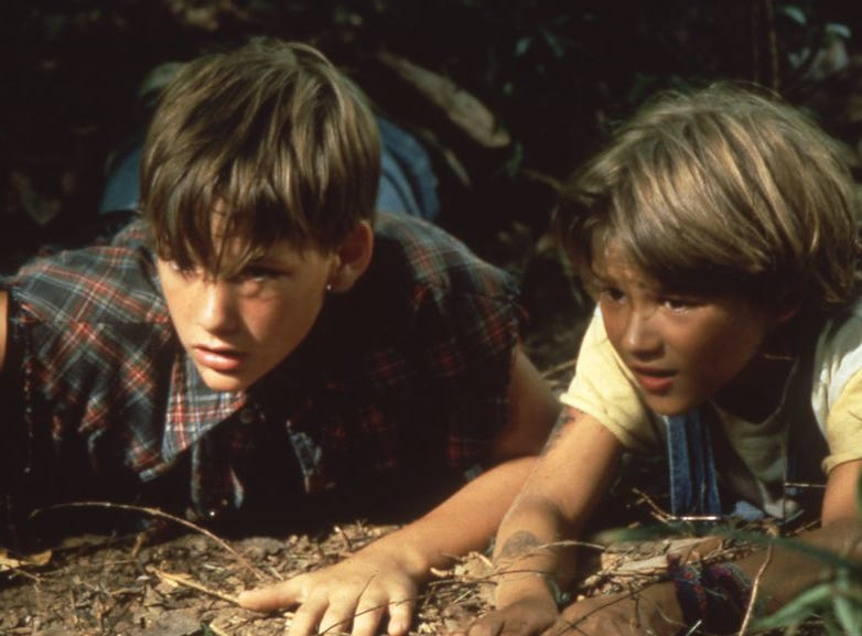 "Mark Sway (Brad Renfro), left, and his brother, Ricky (David Speck), keep an eye on an intruder in ""The Client,"" 1994."