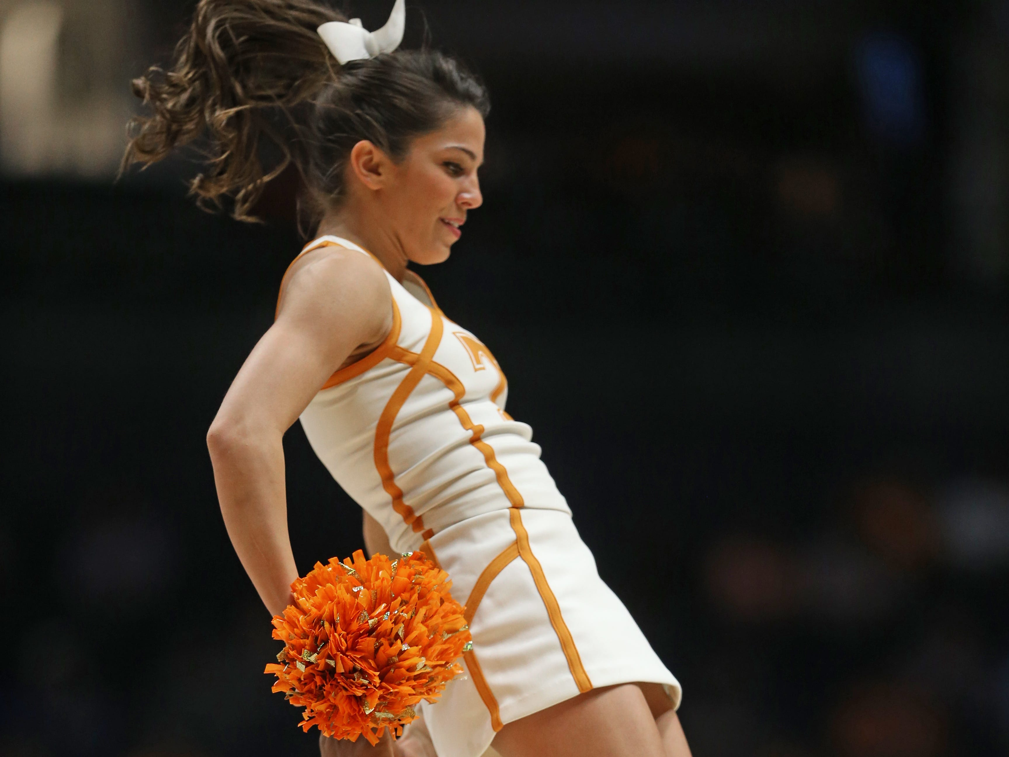 Tennessee cheerleaders perform during the first half of an NCAA college basketball game against Auburn in the Southeastern Conference tournament in Nashville, Tenn., Wednesday, March 9, 2016. (AP Photo/John Bazemore)