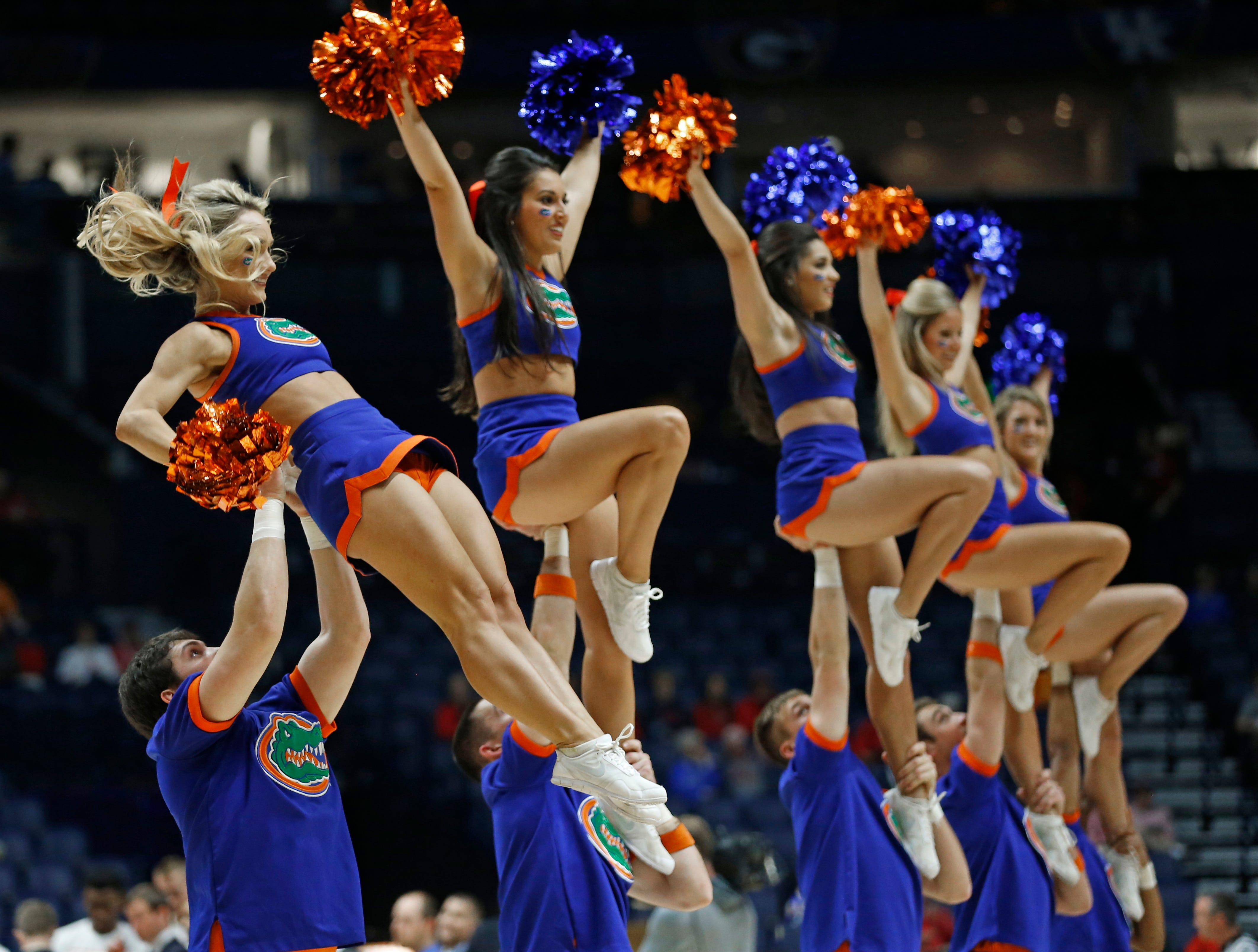 Florida cheerleaders perform during the first half of an NCAA college basketball game against Arkansas in the Southeastern Conference tournament in Nashville, Tenn., Thursday, March 10, 2016. (AP Photo/John Bazemore)