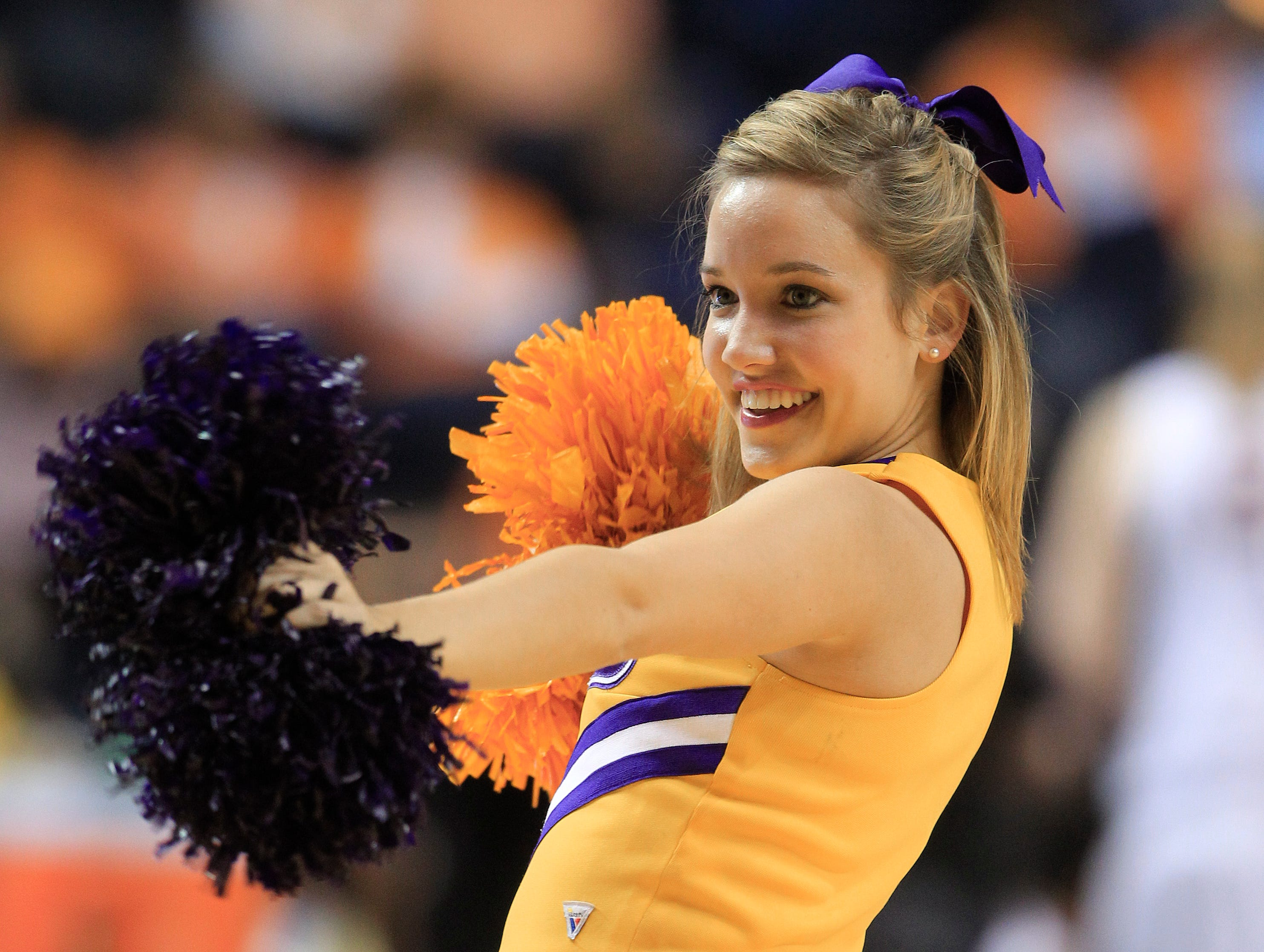 An LSU cheerleader performs in an NCAA college basketball game against Arkansas at the women's Southeastern Conference tournament on Friday, March 2, 2012, in Nashville, Tenn. LSU won 41-40.(AP Photo/Mark Humphrey)