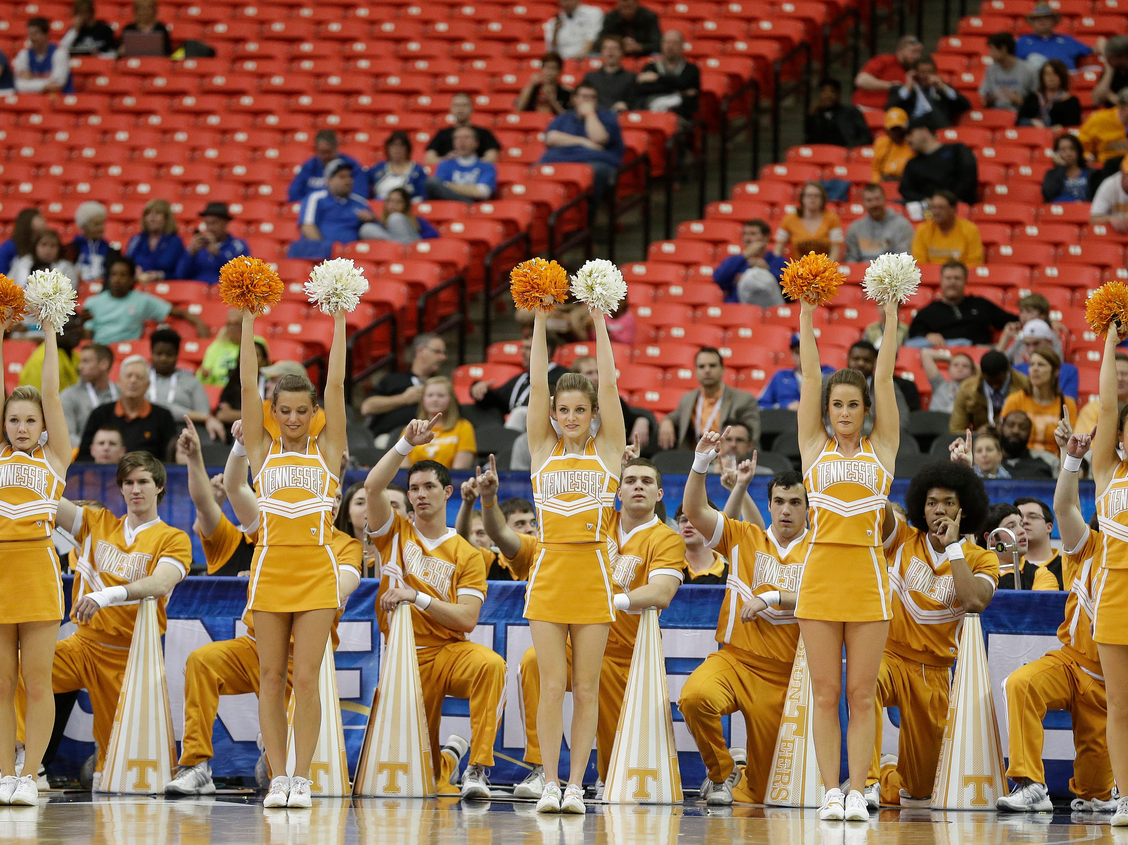 Tennessee cheerleaders perform against South Carolina during the first half of an NCAA college basketball game in the quarterfinal round of the Southeastern Conference men's tournament, Friday, March 14, 2014, in Atlanta. (AP Photo/Steve Helber)