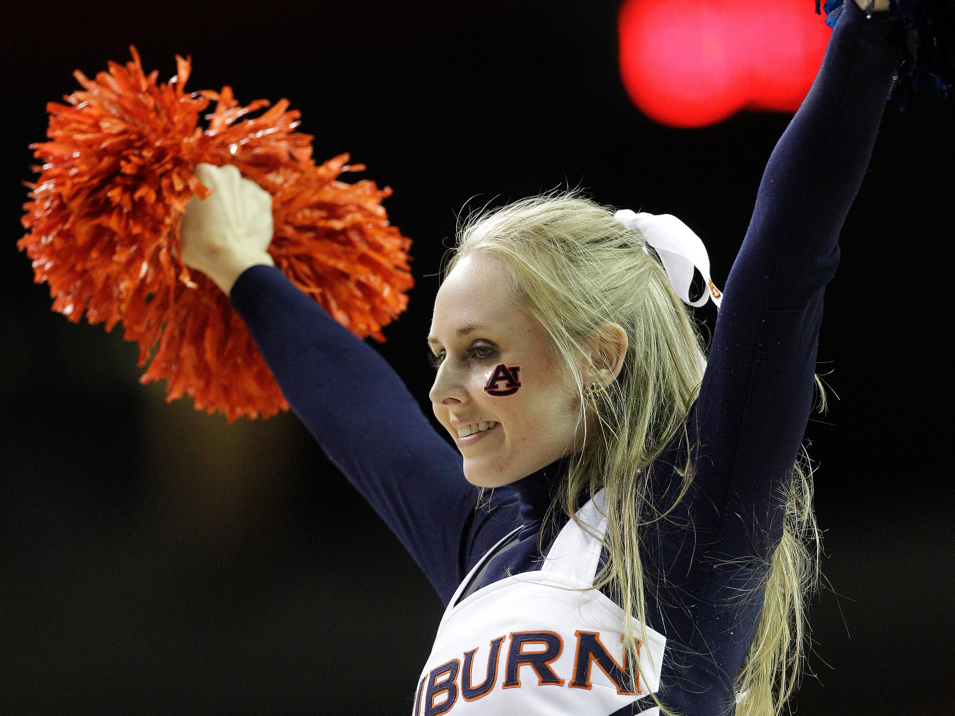 Auburn cheerleaders perform during the first half in a first round Southeastern Conference tournament game against South Carolina, Wednesday, March 12, 2014, in Atlanta.  (AP Photo/Steve Helber)
