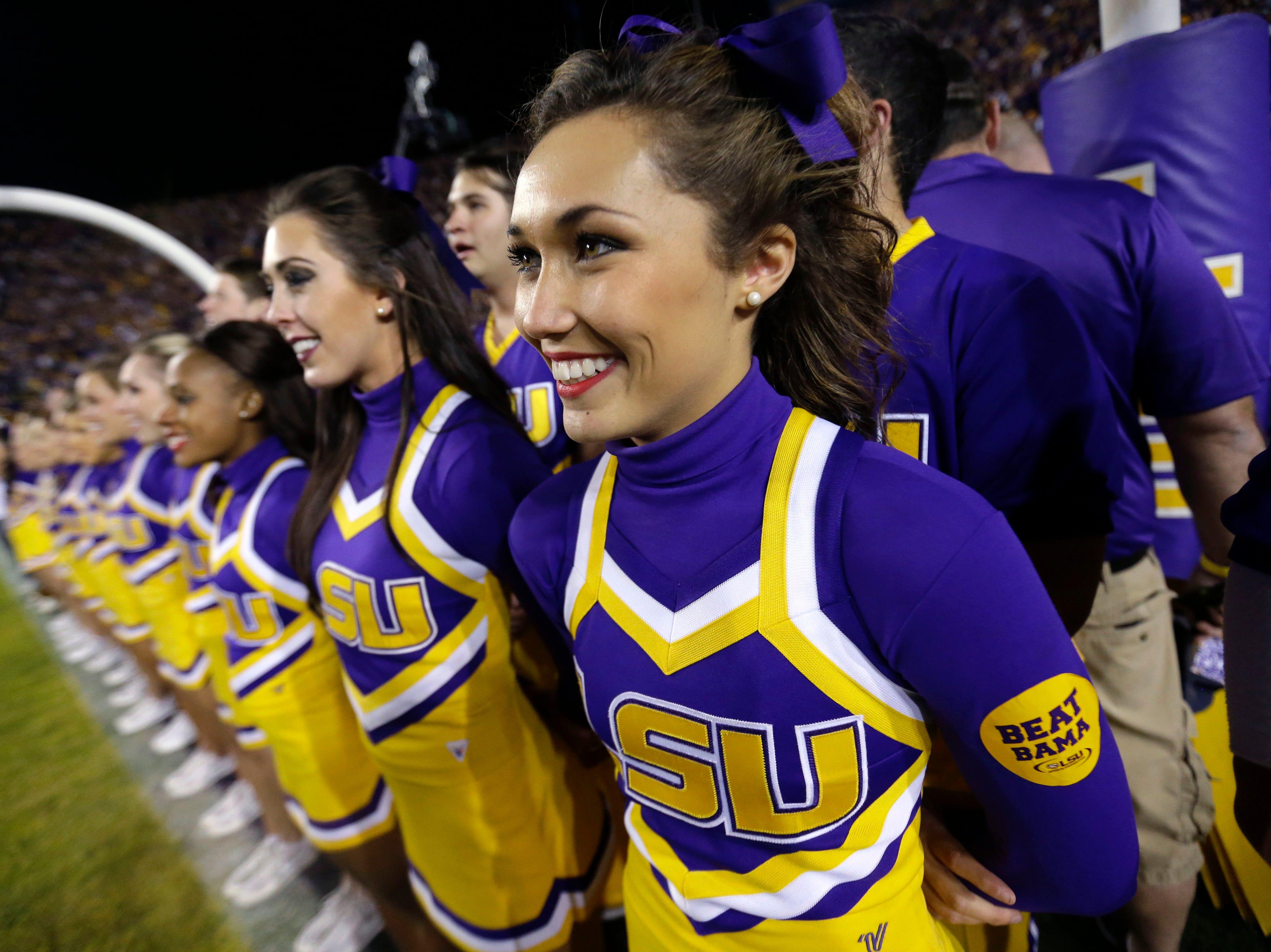 LSU cheerleaders sing the school anthem before an NCAA college football game against Alabama in Baton Rouge, La., Saturday, Nov. 8, 2014. Alabama won in overtime 20-13. (AP Photo/Gerald Herbert)