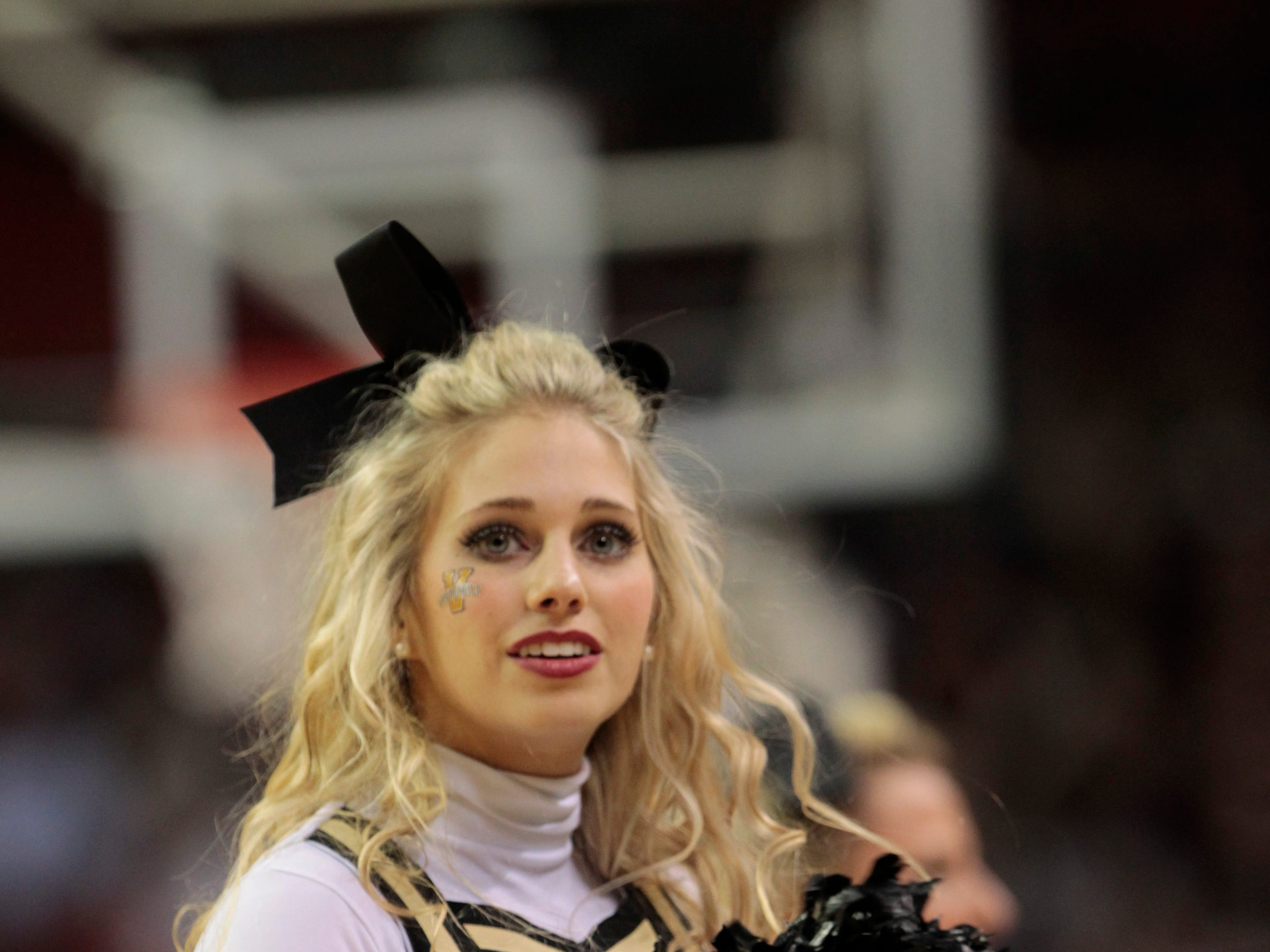 Vanderbilt cheerleaders perform during the first half of an NCAA college basketball game against Mississippi State at the Southeastern Conference tournament, Friday, March 11, 2011, in Atlanta. (AP Photo/Dave Martin)