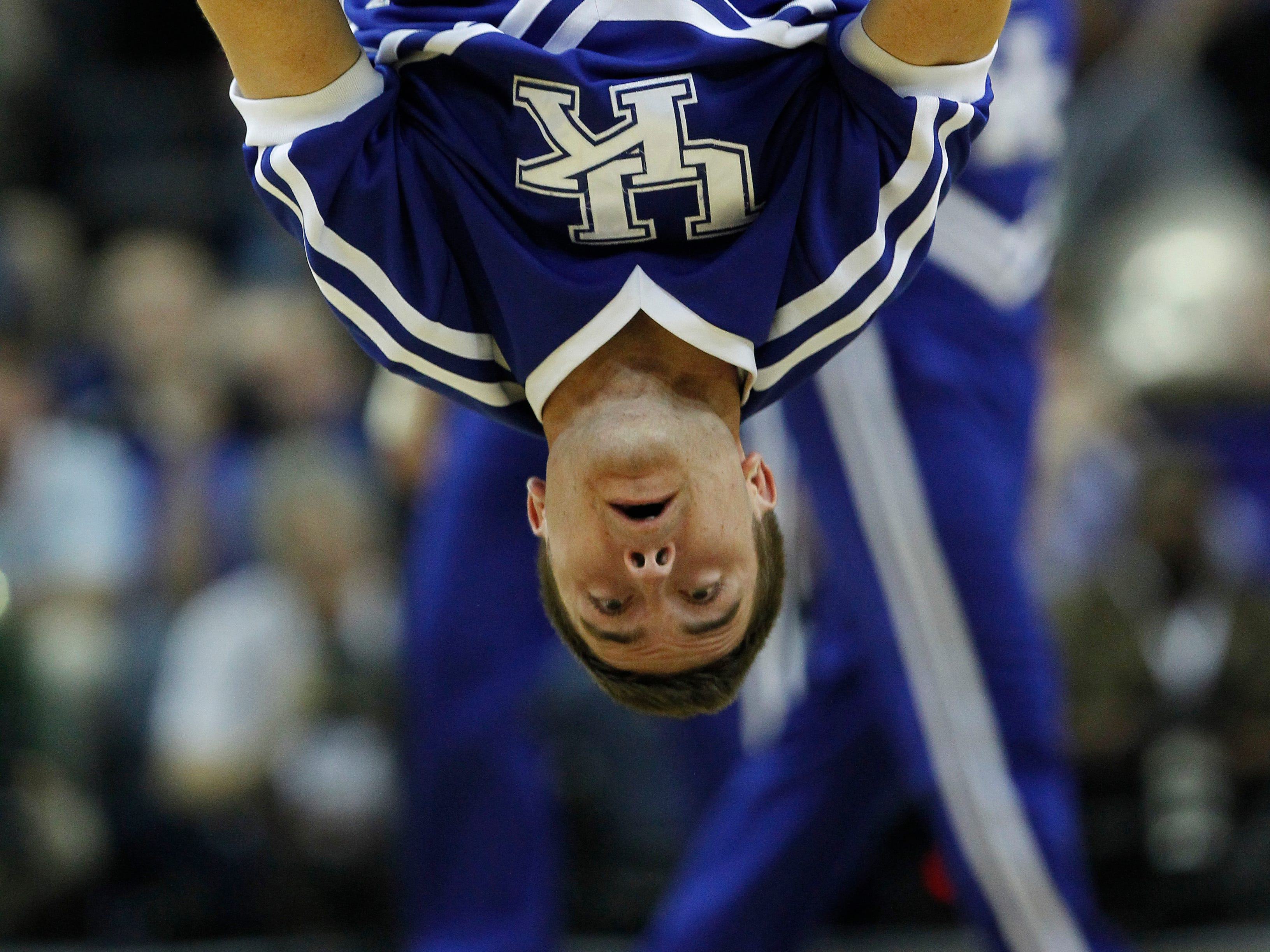 A Kentucky cheerleader performs during the first half of an NCAA college basketball game in the championship game of the 2012 Southeastern Conference tournament at the New Orleans Arena in New Orleans, Sunday, March 11, 2012. (AP Photo/Gerald Herbert)
