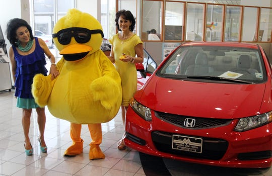 In this file photo, Clara Broussard, winner of a new Honda Civic in the 2012 Running of the Ducks, gets her car at Moss Motors in Lafayette.