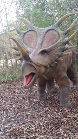 Prehistoric Park boasts giant dinosaur replicas in a swampy terrain