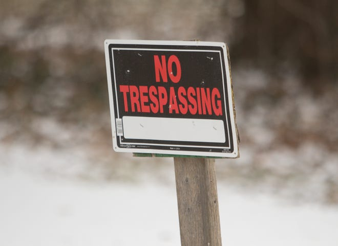 A sign along the drive of Heavenly Acres Pet Cemetery in Genoa Township, shown Thursday, Jan. 3, 2019, reflects the closure of the cemetery.