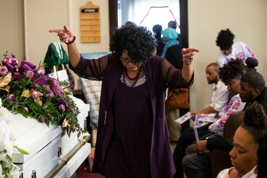 Ernestine Tyus returns to her seat following her speech during the funeral service for her grandson, Ki'Anthony Tyus, 13, who died following a police chase car crash on Dec. 22. The funeral took place at Cornerstone Missionary Baptist Church on Bolling Avenue in Louisville.