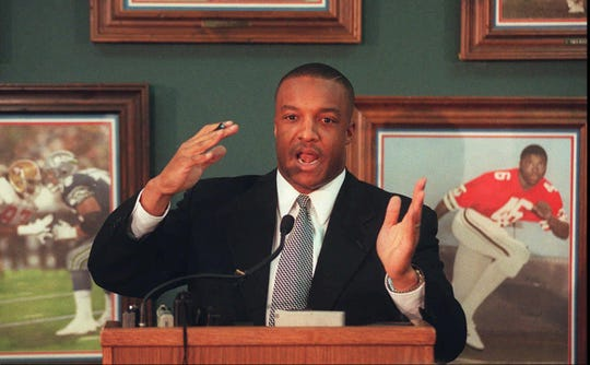 Ron Cooper speaks at a press conference after he was fired by Louisville.