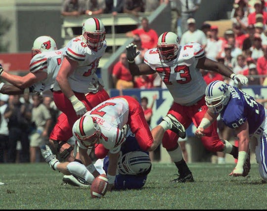 Chris Redman scrambles over a UK player as he goes after his fumble in a 1997 game.