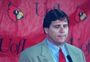 Tom Jurich speaks at a press conference announcing Ron Cooper's firing. Nov. 19, 1997