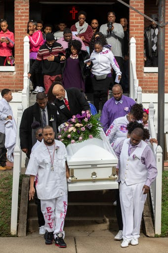 The casket of Ki'Anthony Tyus, a 13-year-old who died following a police chase car crash on Dec. 22, is carried out of Cornerstone Missionary Baptist Church on Bolling Avenue in Louisville, Ky on Thursday. Jan. 3, 2019
