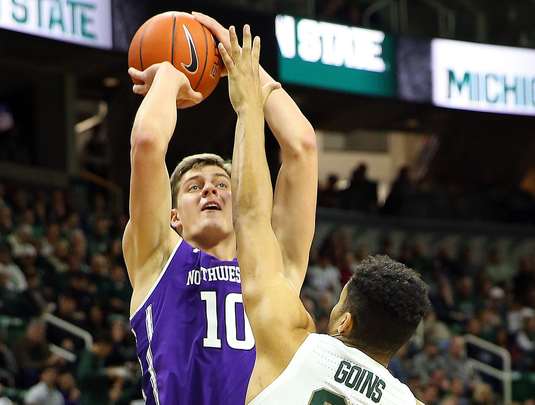 Jan 2, 2019; East Lansing, MI, USA; Northwestern Wildcats forward Miller Kopp (10) shoots over Michigan State Spartans forward Kenny Goins (25) during the first half of a game at the Breslin Center. Mandatory Credit: Mike Carter-USA TODAY Sports