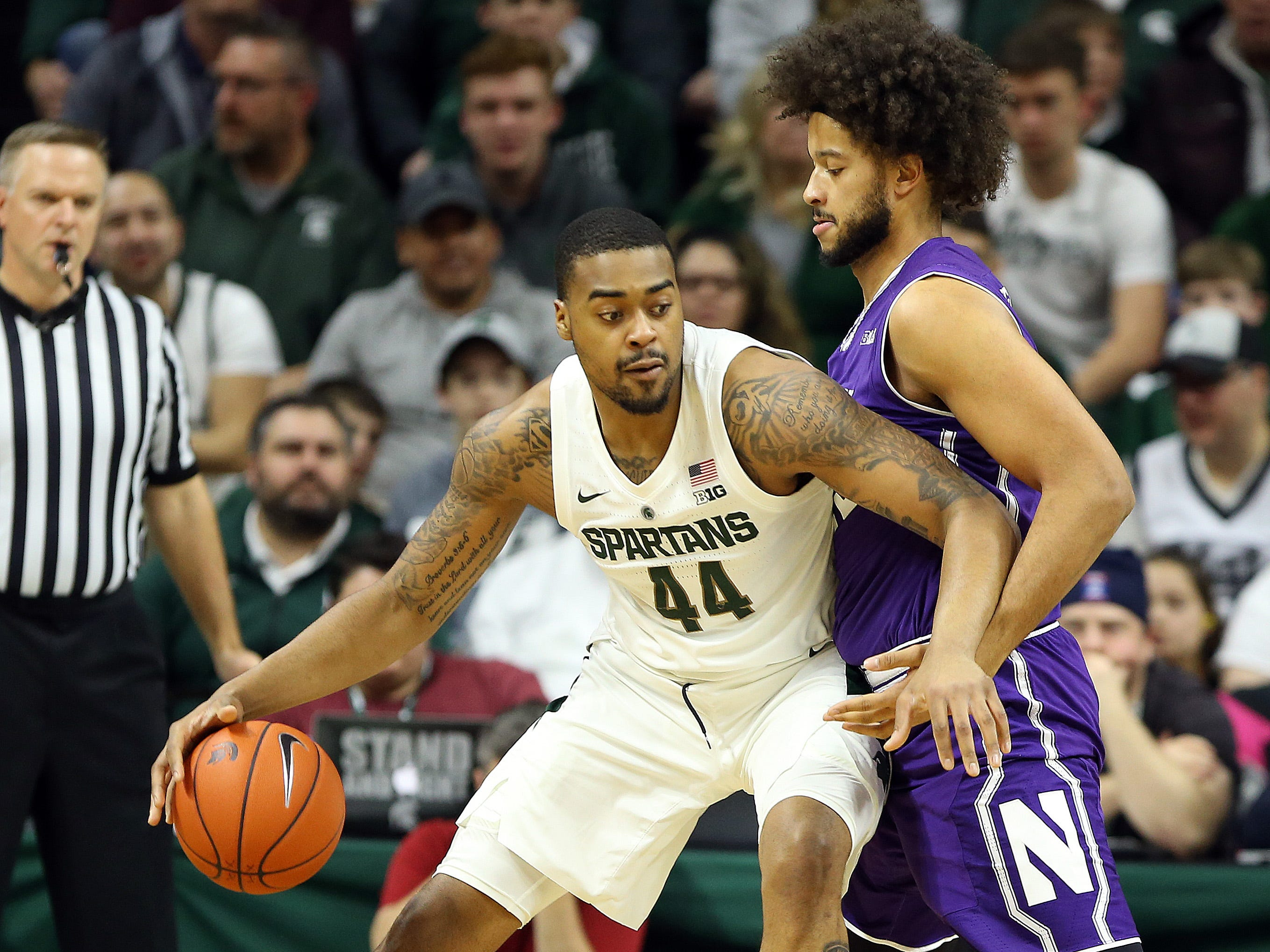 Jan 2, 2019; East Lansing, MI, USA; Michigan State Spartans forward Nick Ward (44) is defended by Northwestern Wildcats center Barret Benson (25) during the first half of a game at the Breslin Center. Mandatory Credit: Mike Carter-USA TODAY Sports