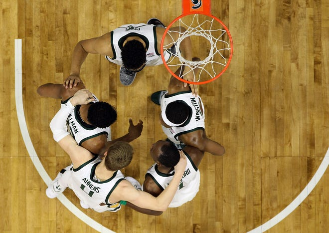 Clockwise: Michigan State's Kenny Goins, top, Cassius Winston, Joshua Langford, Kyle Ahrens and Xavier Tillman huddle during MSU's win over Iowa last month. This team, as much as any Tom Izzo has had, is a better collective, in large part because of the strength of its role players.