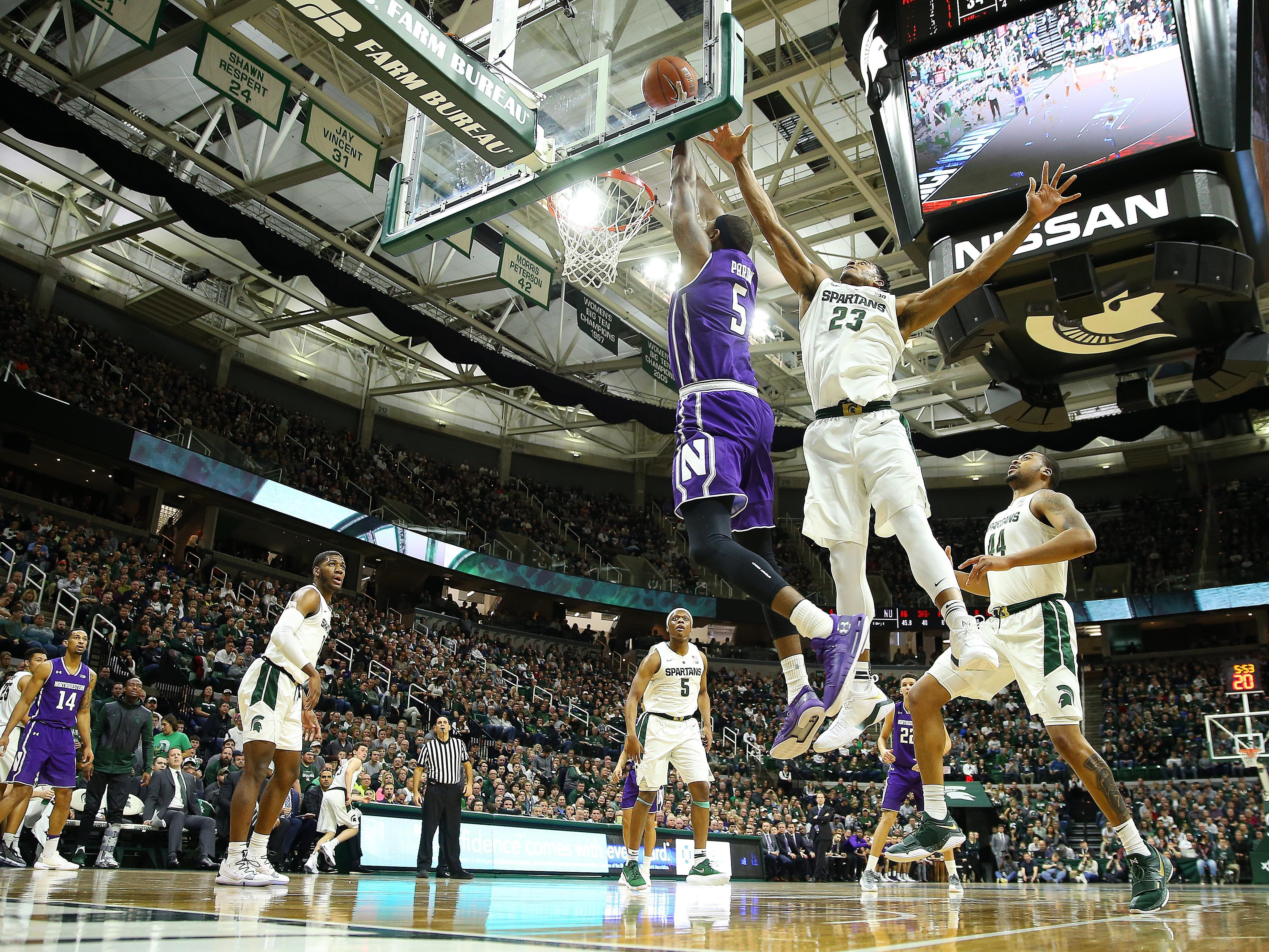 Jan 2, 2019; East Lansing, MI, USA; Michigan State Spartans forward Xavier Tillman (23) blocks the shot of Northwestern Wildcats center Dererk Pardon (5) during the first half of a game at the Breslin Center. Mandatory Credit: Mike Carter-USA TODAY Sports