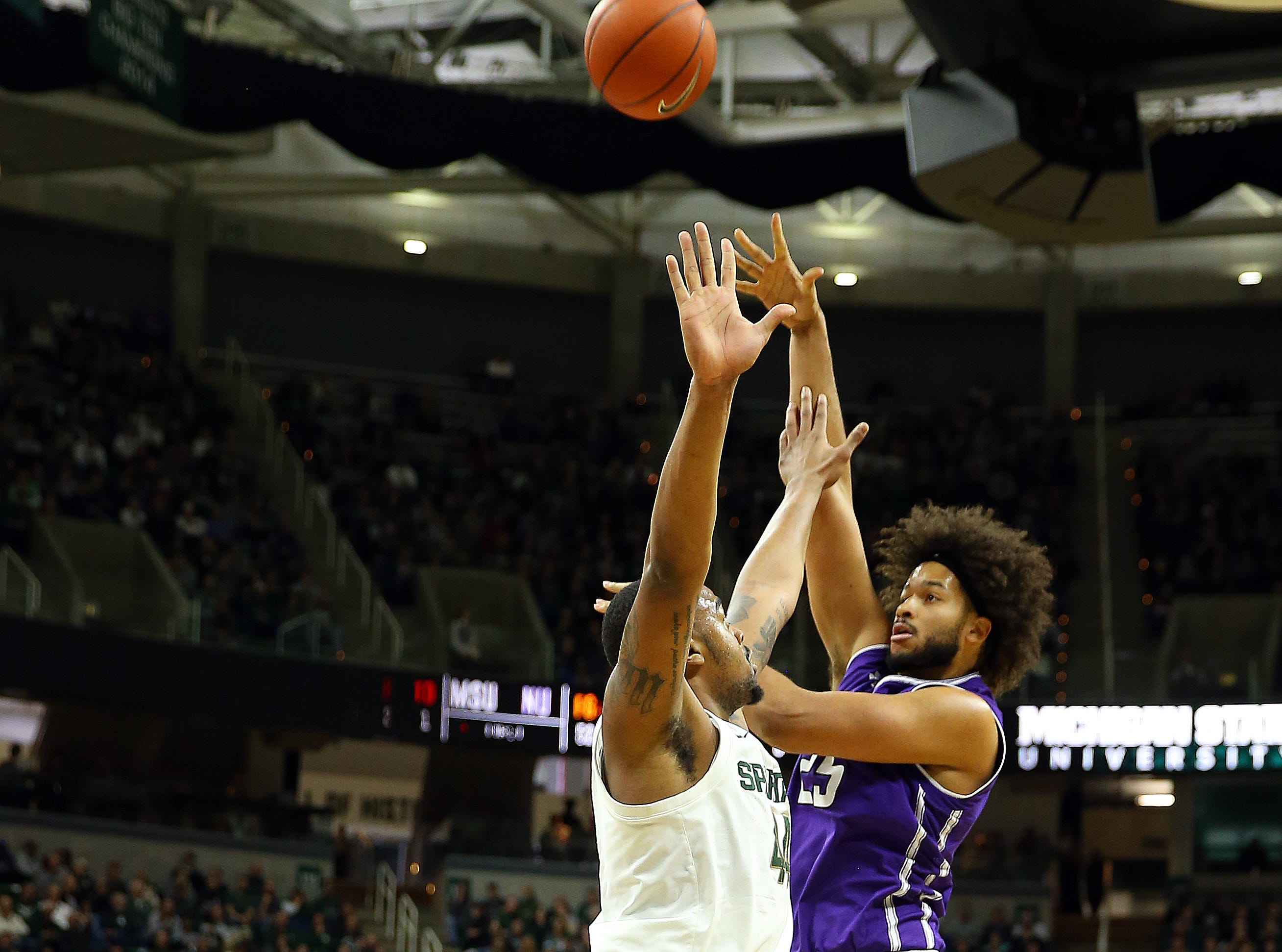 Jan 2, 2019; East Lansing, MI, USA; Northwestern Wildcats center Barret Benson (25) shoots over Michigan State Spartans forward Nick Ward (44) during the first half of a game at the Breslin Center. Mandatory Credit: Mike Carter-USA TODAY Sports