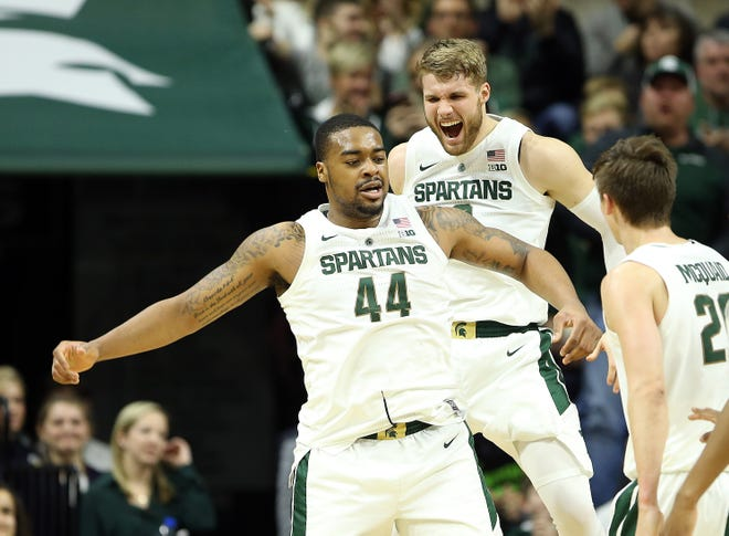 Jan 2, 2019; East Lansing, MI, USA; Michigan State Spartans forward Nick Ward (44) and Michigan State Spartans forward Kyle Ahrens (0) react during the first half of a game against the Northwestern Wildcats at the Breslin Center. Mandatory Credit: Mike Carter-USA TODAY Sports