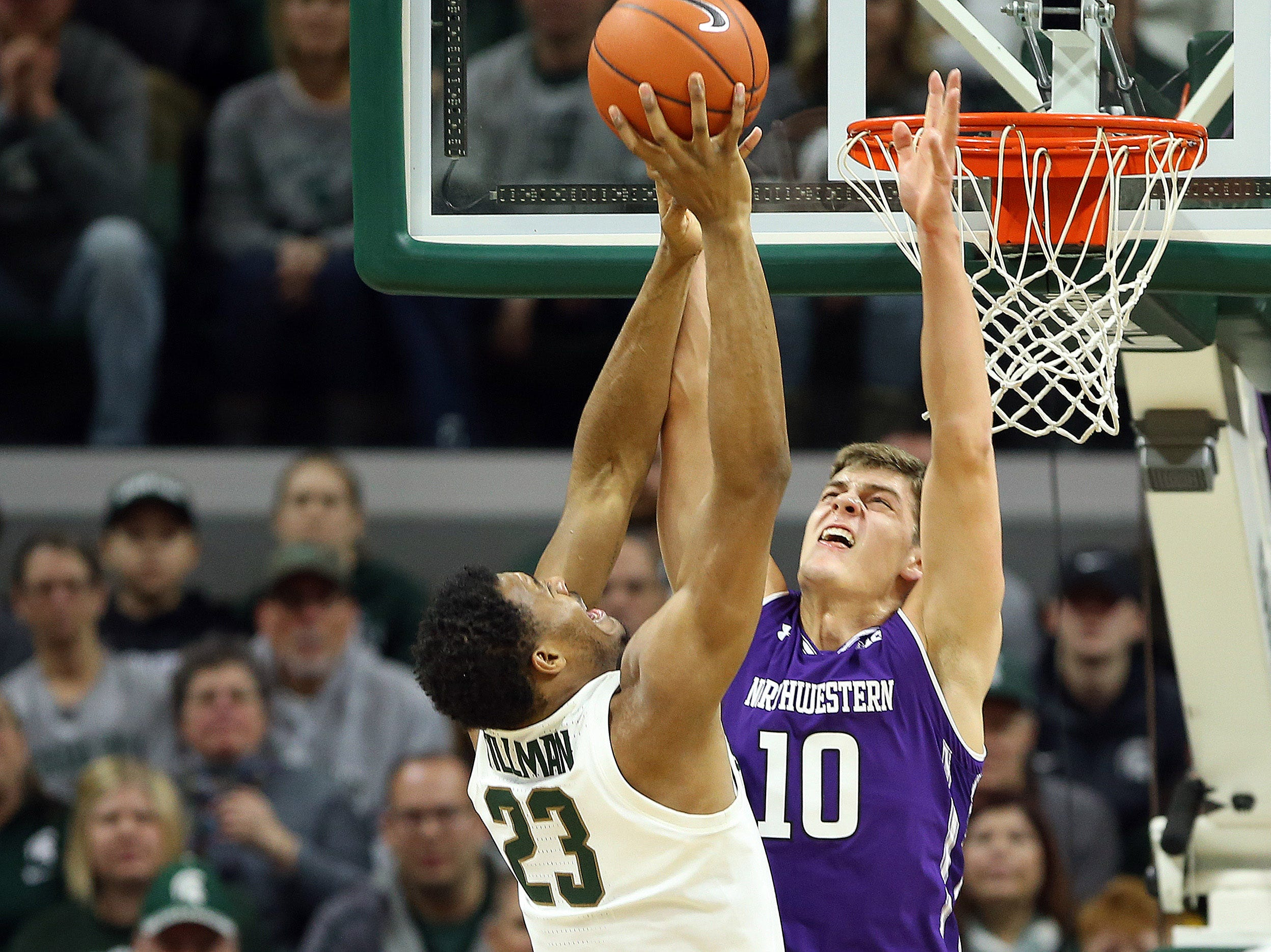 Jan 2, 2019; East Lansing, MI, USA; Michigan State Spartans forward Xavier Tillman (23) shoots the ball over Northwestern Wildcats forward Miller Kopp (10) during the first half of a game at the Breslin Center. Mandatory Credit: Mike Carter-USA TODAY Sports