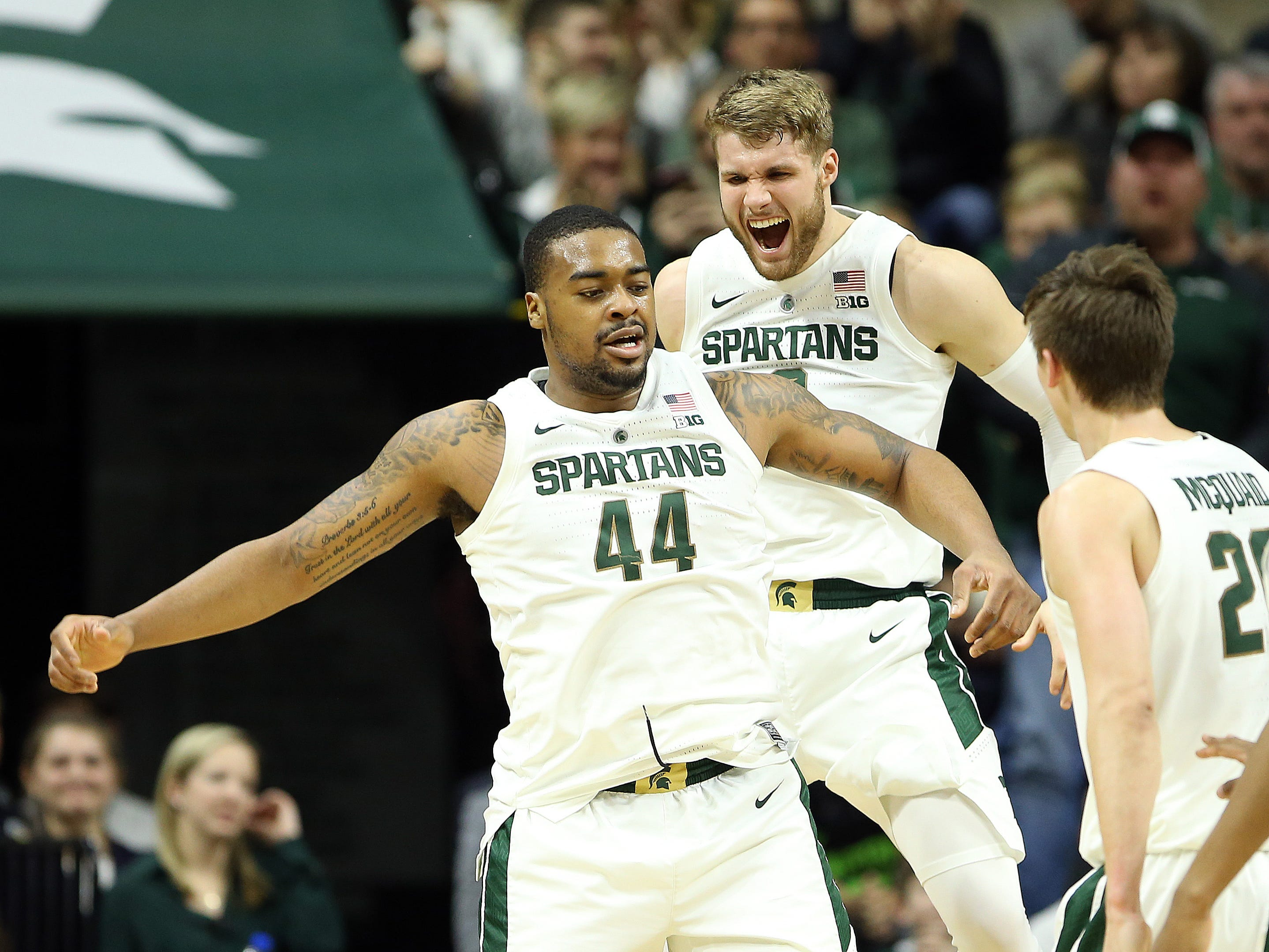 Michigan State forwards Nick Ward (44) and forward Kyle Ahrens react during the first half against Northwestern at the Breslin Center in East Lansing, Jan. 2, 2019.