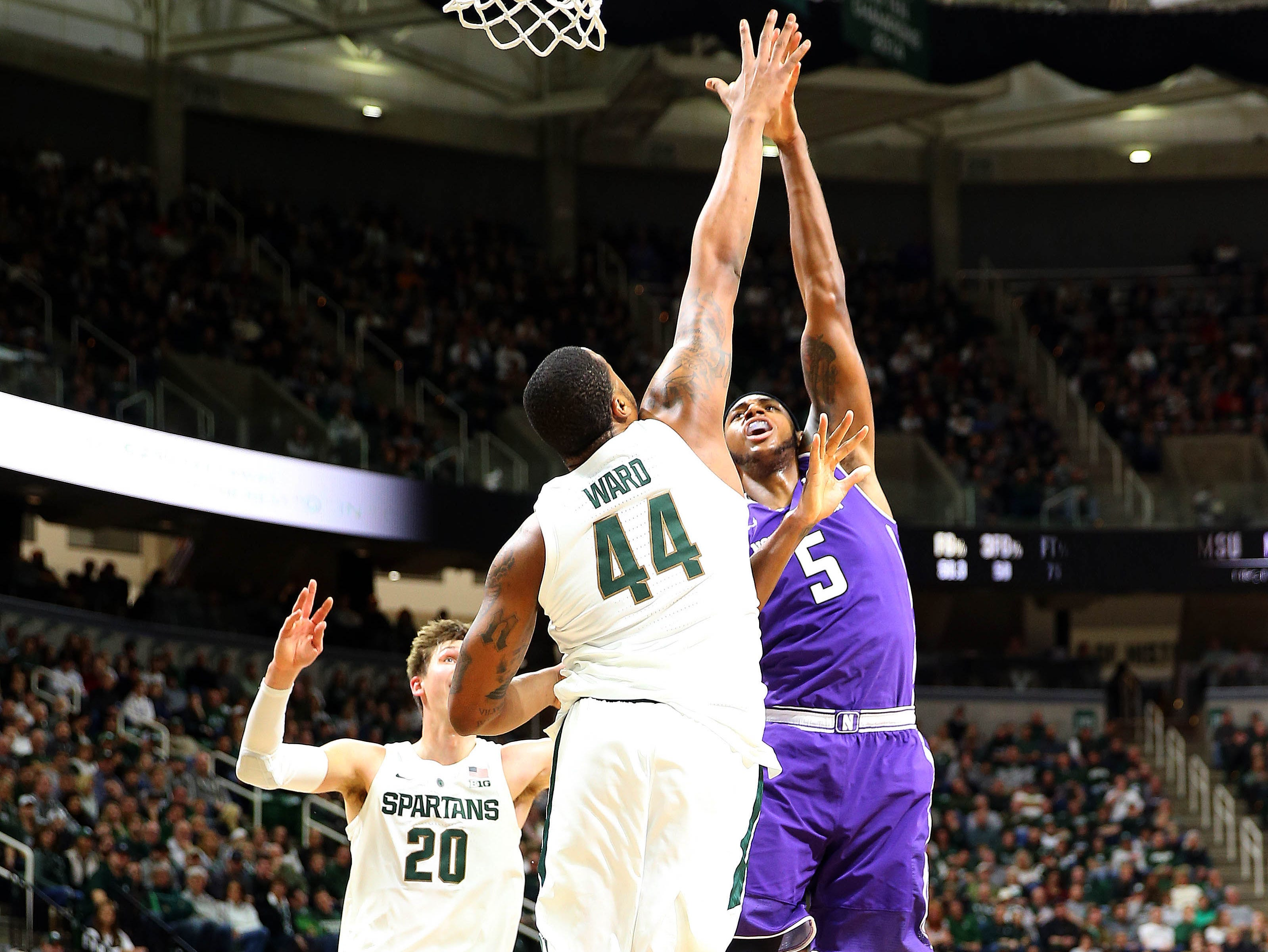 Jan 2, 2019; East Lansing, MI, USA; Northwestern Wildcats center Dererk Pardon (5) is defended by Michigan State Spartans forward Nick Ward (44) during the first half of a game at the Breslin Center. Mandatory Credit: Mike Carter-USA TODAY Sports
