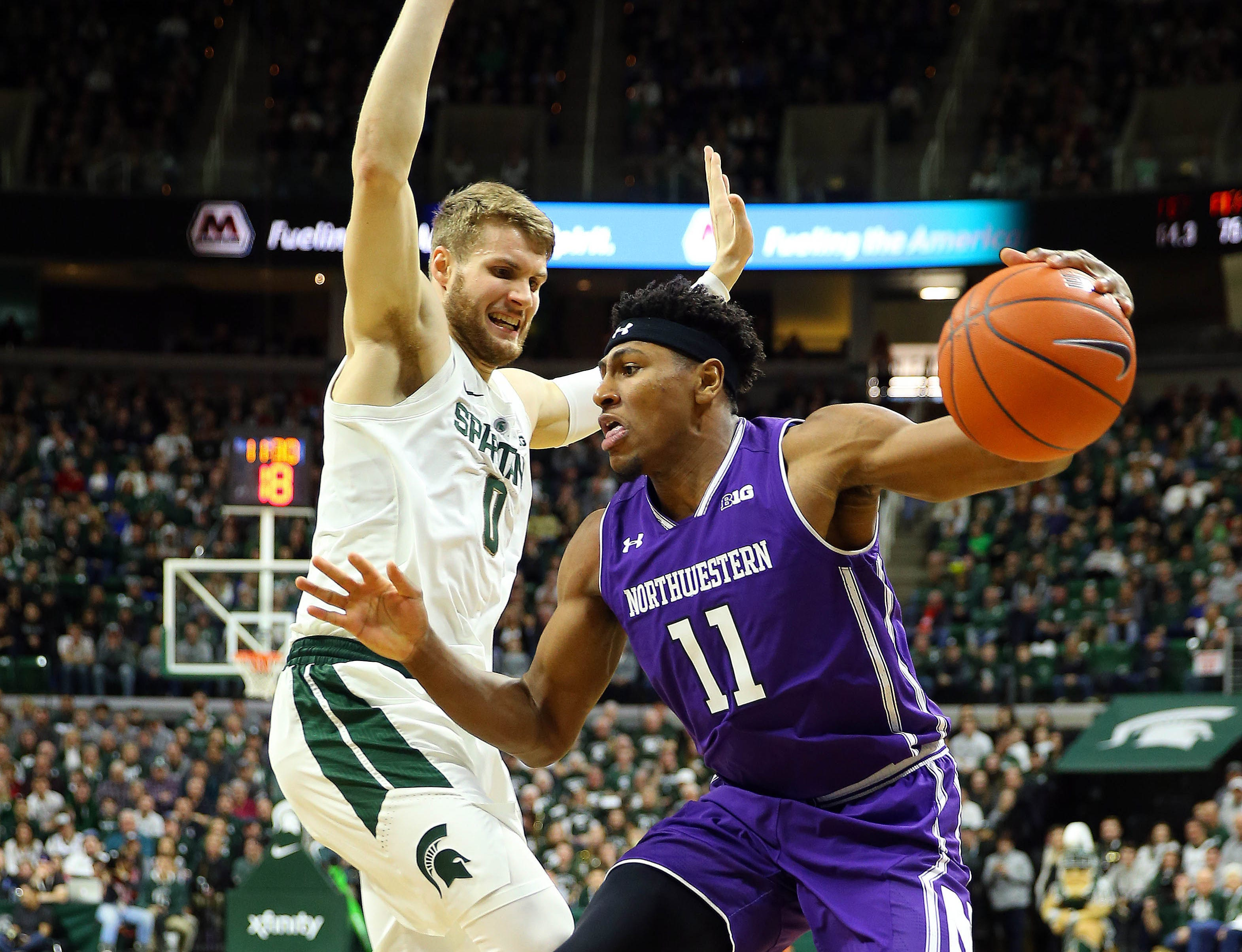Jan 2, 2019; East Lansing, MI, USA; Northwestern Wildcats guard Anthony Gaines (11) drives to the basket against Michigan State Spartans forward Kyle Ahrens (0) during the first half of a game at the Breslin Center. Mandatory Credit: Mike Carter-USA TODAY Sports