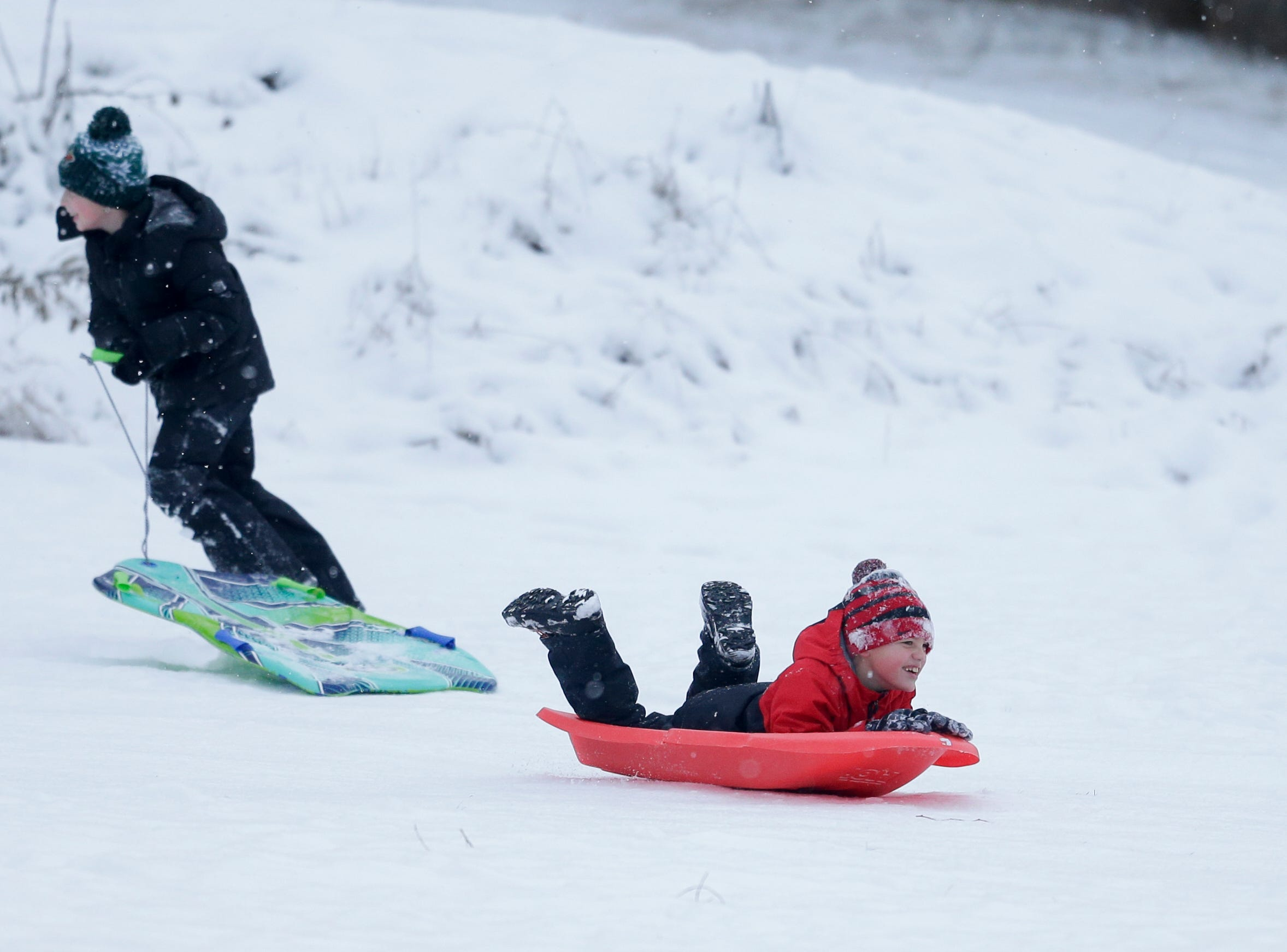 Miles Rice, 7, flies down the sledding hill at Silver Creek Park Wednesday, January 2, 2019, in Manitowoc, Wis. Joshua Clark/USA TODAY NETWORK-Wisconsin