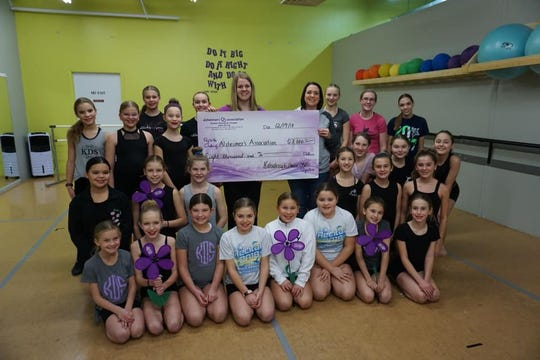 Kaleidoscope Dance Studio gave $8,000 to the Alzheimer's Association Greater Wisconsin Chapter. The money was raised during the group's annual 'Tis the Season Holiday recital.
