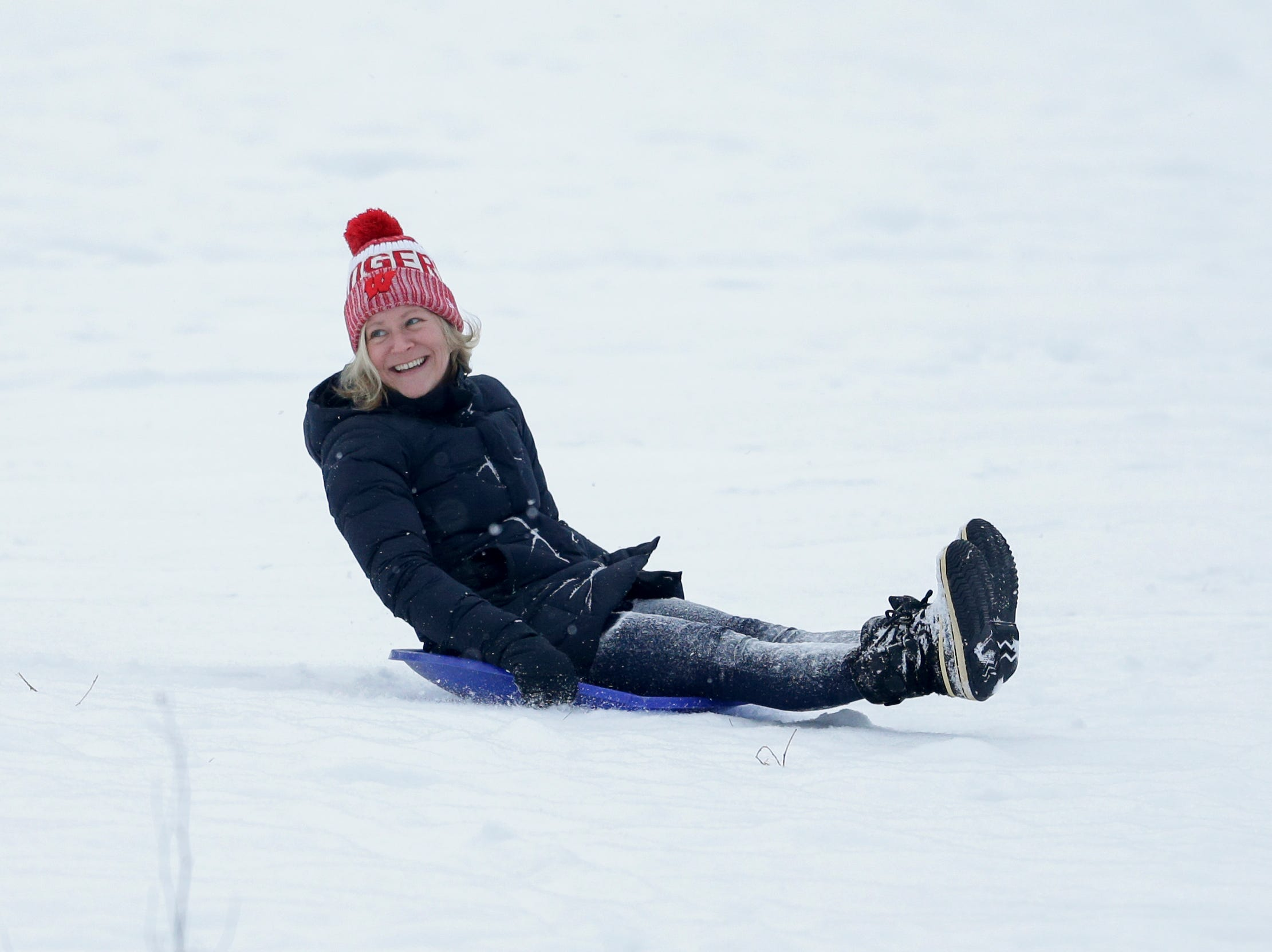 Carrie Dunn takes a turn down the hill while sledding with her son at Silver Creek Park Wednesday, January 2, 2019, in Manitowoc, Wis. Joshua Clark/USA TODAY NETWORK-Wisconsin