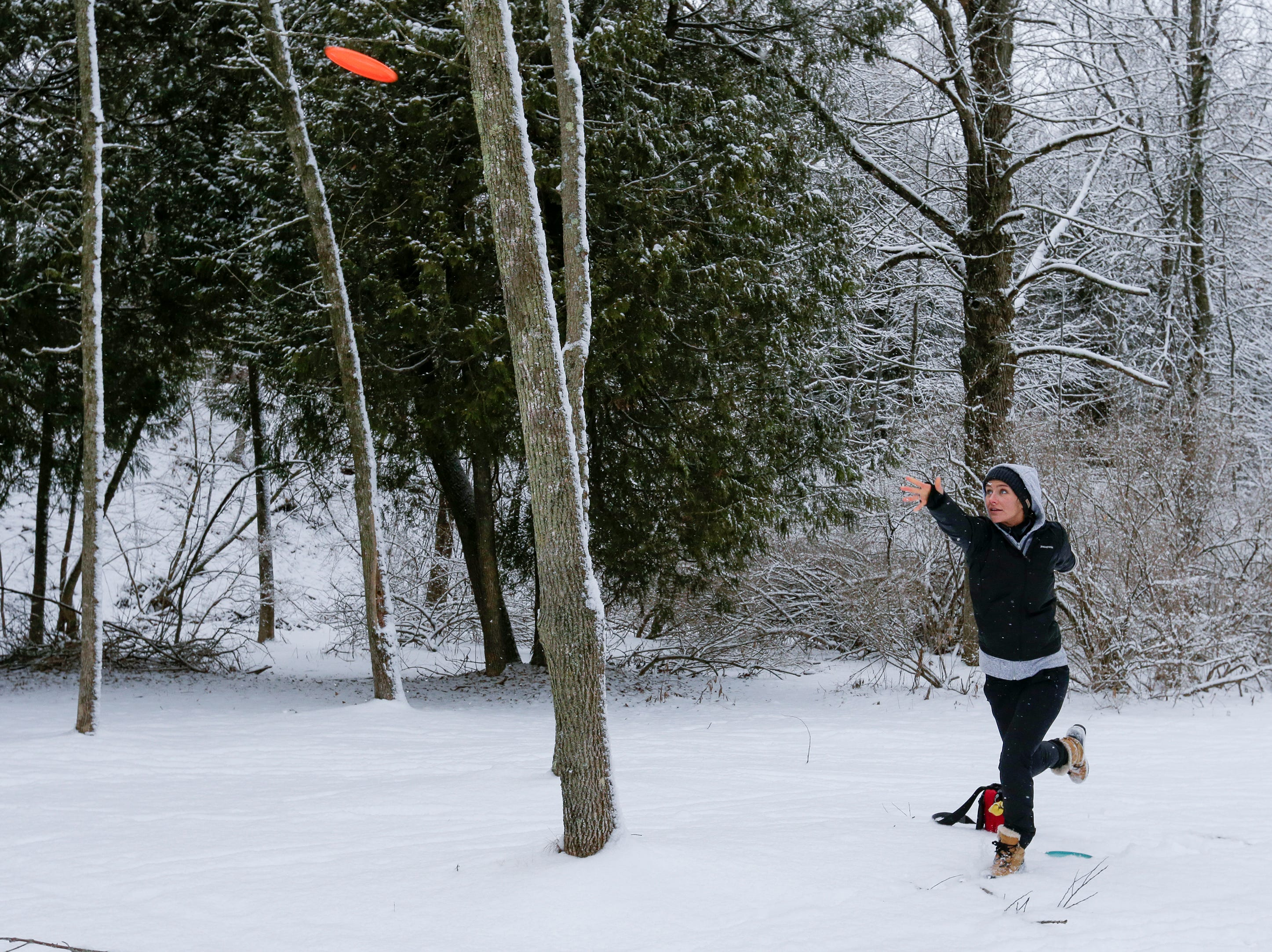 Elizabeth Emmeneger, of Milwaukee, plays a round of disc golf in the snow at Silver Creek Park Wednesday, January 2, 2019, in Manitowoc, Wis. Joshua Clark/USA TODAY NETWORK-Wisconsin