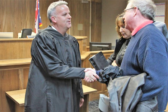 Jason Warner shakes hands after being sworn in as a Marion County Common Pleas Court Judge on Thursday, Dec. 27. Before being elected in November, he served as a magistrate in Marion Municipal Court for seven years.