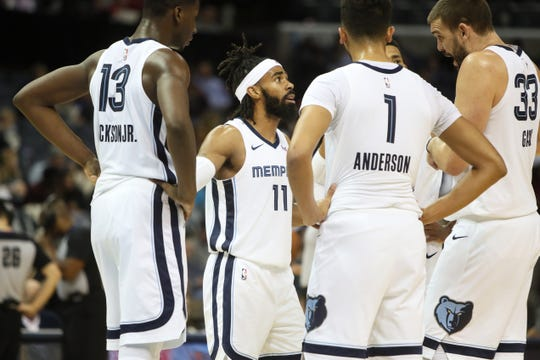 Grizzlies guard Mike Conley talks to teammates including Marc Gasol, right, during Memphis' game against the Detroit Pistons on Jan. 2.