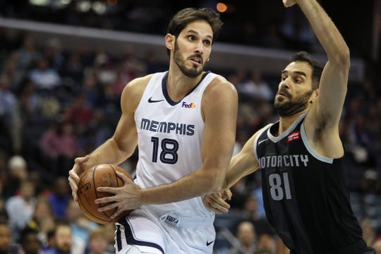 Grizzlies forward Omri Casspi drives the baseline against Pistons guard Jose Calderon on Wednesday. Casspi was involved in a physical altercation with teammate Garrett Temple after the game, according to a report from The Athletic.