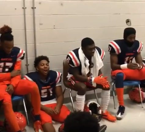 Ridgeway High players in 2016 await a game during a rain delay. They players took the break in the action to make a hype video that went viral and is now part of an National Football League commercial.