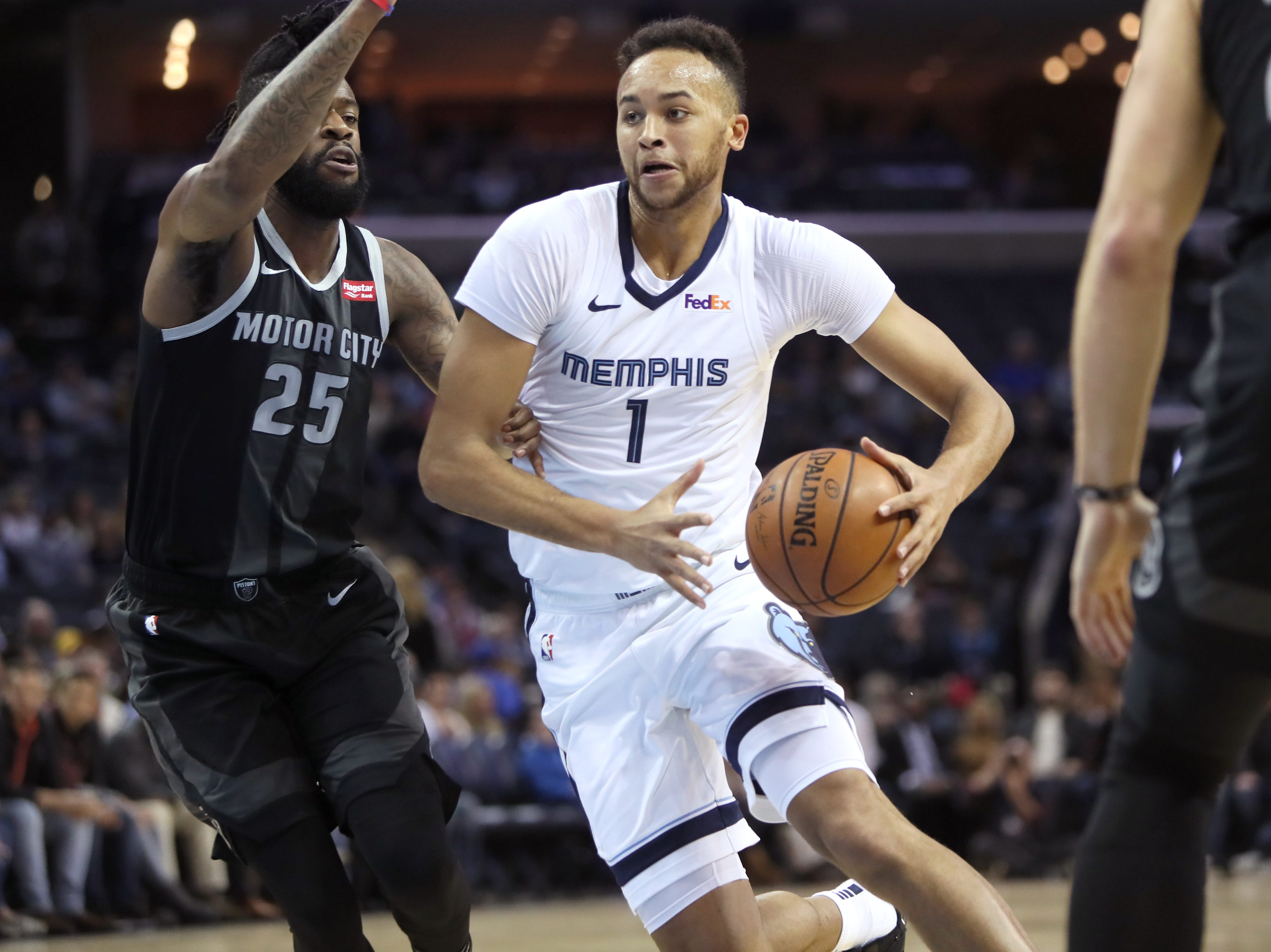 Memphis Grizzlies guard Kyle Anderson drives past Detroit Pistons guard Reggie Bullock during their game at the FedExForum on Wednesday, January 2, 2019.